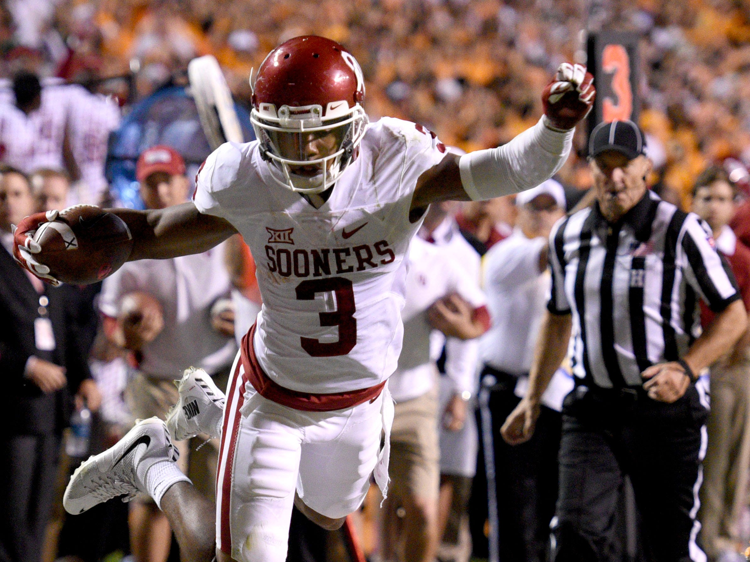 Oklahoma wide receiver Sterling Shepard (3) dives over Tennessee defensive back Brian Randolph (37) for a touchdown to win the game 31-24 at Neyland Stadium on Saturday, Sept. 12, 2015 in Knoxville, Tenn.