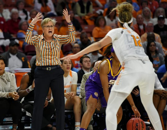 Tennessee head coach Holly Warlick, left, reacts during the first half of an NCAA college basketball game against LSU in the Southeastern Conference women's tournament, Thursday, March 7, 2019, in Greenville, S.C.