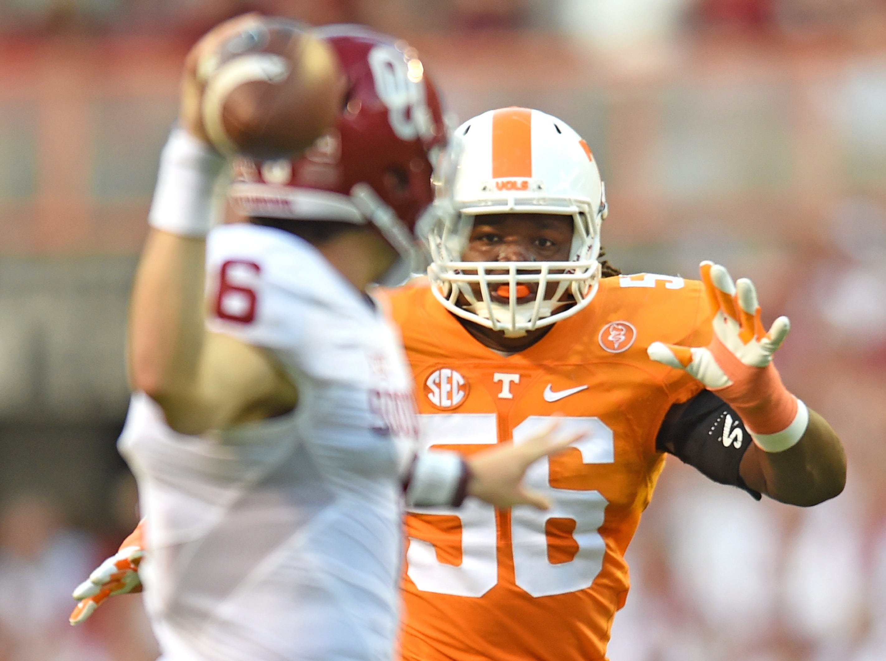 Tennessee defensive lineman/linebacker Curt Maggitt (56) rushes Oklahoma quarterback Baker Mayfield (6) during the first half at Neyland Stadium on Saturday, Sept. 12, 2015.
