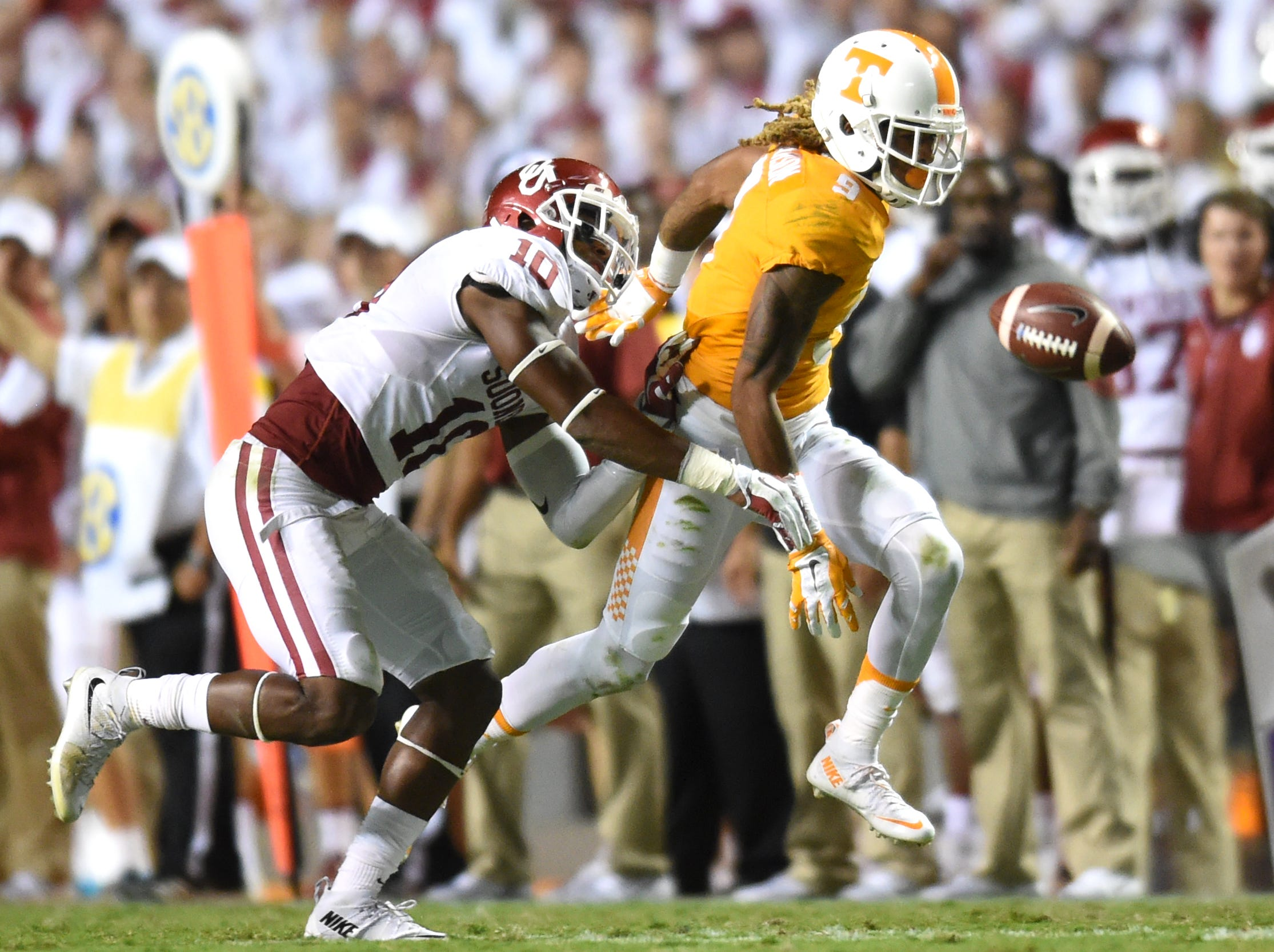A pass intended for Tennessee wide receiver Von Pearson (9) falls incomplete as Oklahoma safety Steven Parker (10) defends during the second half at Neyland Stadium on Saturday, Sept. 12, 2015 in Knoxville, Tenn.