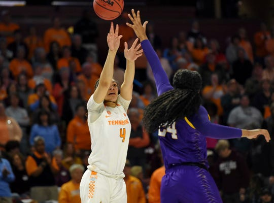 Tennessee's Mimi Collins (4) shoots over LSU's Faustine Aifuwa during the first half of Thursday's game.