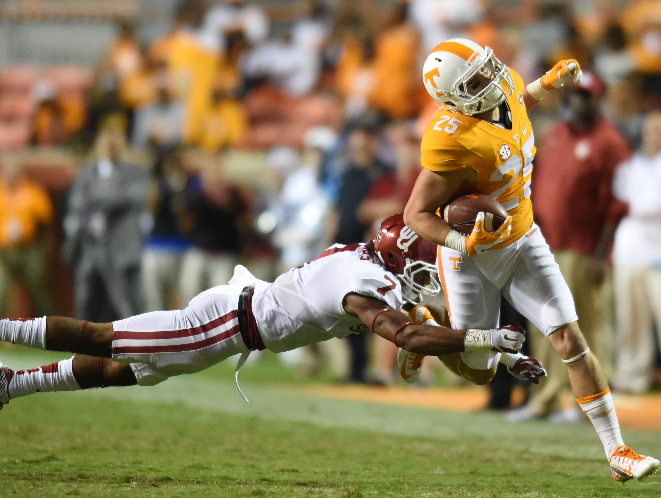 Oklahoma cornerback Jordan Thomas (7) tries to stop Tennessee wide receiver Josh Smith (25) during the second half at Neyland Stadium on Saturday, Sept. 12, 2015 in Knoxville, Tenn.