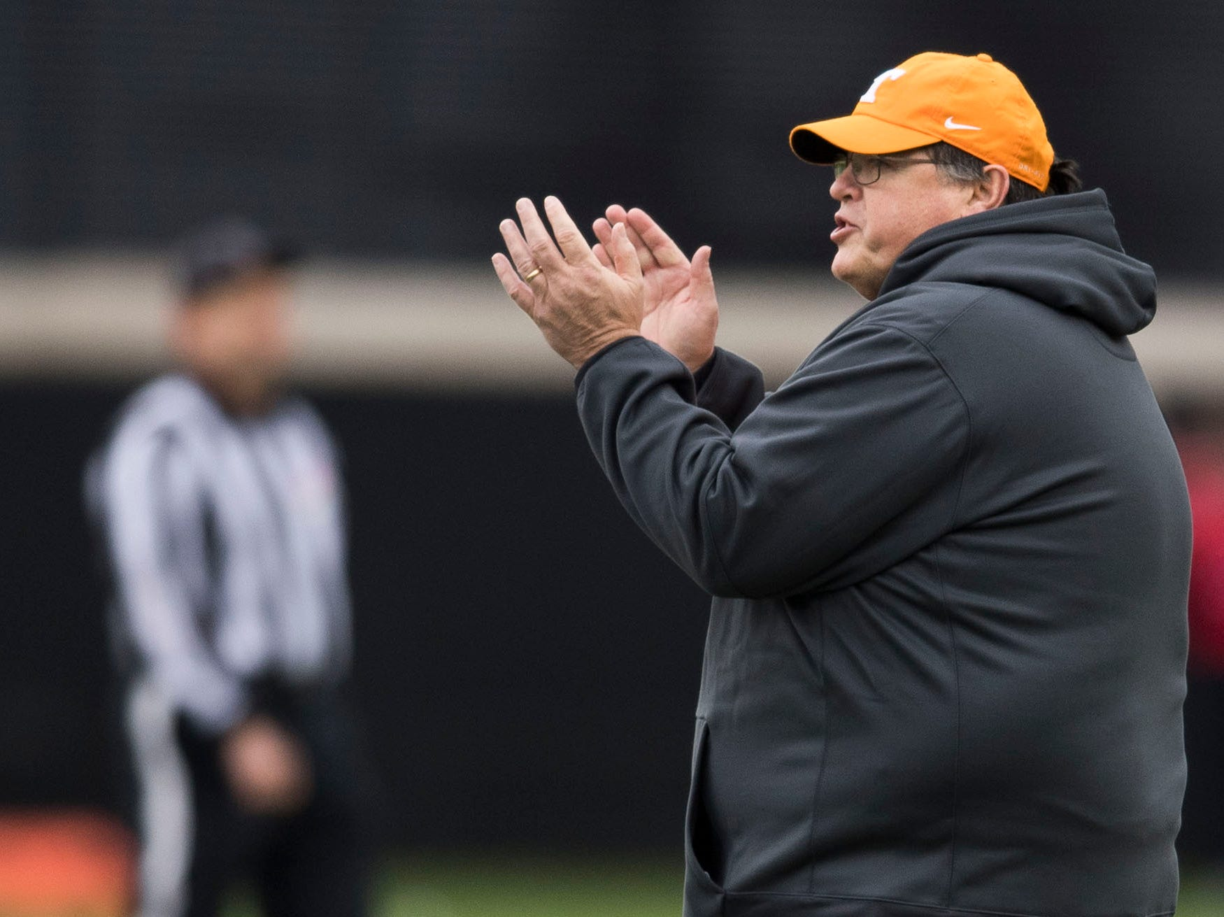 Tennessee offensive coordinator Jim Chaney claps on the field during Tennessee football's first practice of the spring season at University of Tennessee Thursday, March 7, 2019.