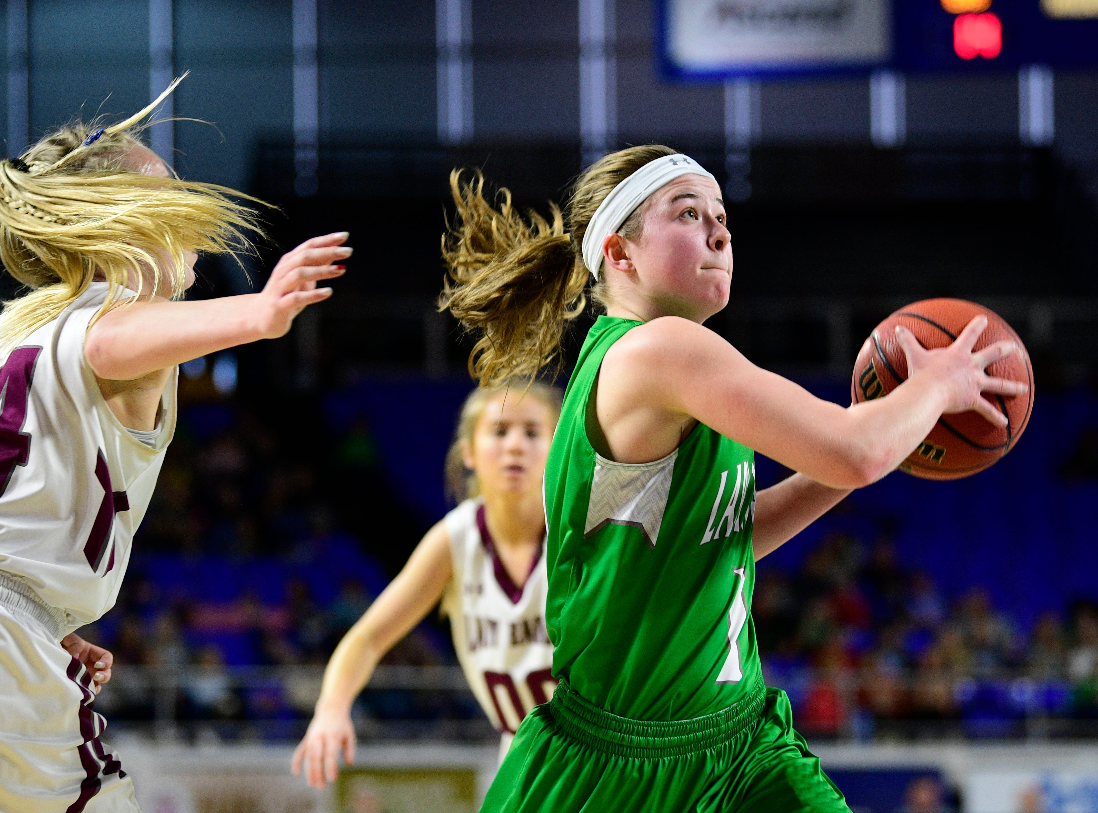 Midway's Caitlyn Ross (1) goes for a layup as Eagleville's Anna Grace Clement (24) defends during a game between Eagleville and Midway at the TSSAA girls state tournament at the Murphy Center in Murfreesboro, Tennessee on Thursday, March 7, 2019.
