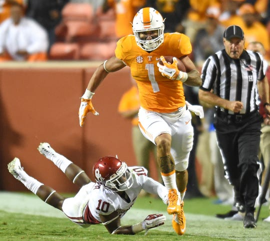 Tennessee running back Jalen Hurd (1) dodges a tackle by Oklahoma safety Steven Parker (10) during the second half at Neyland Stadium on Saturday, Sept. 12, 2015 in Knoxville, Tenn.