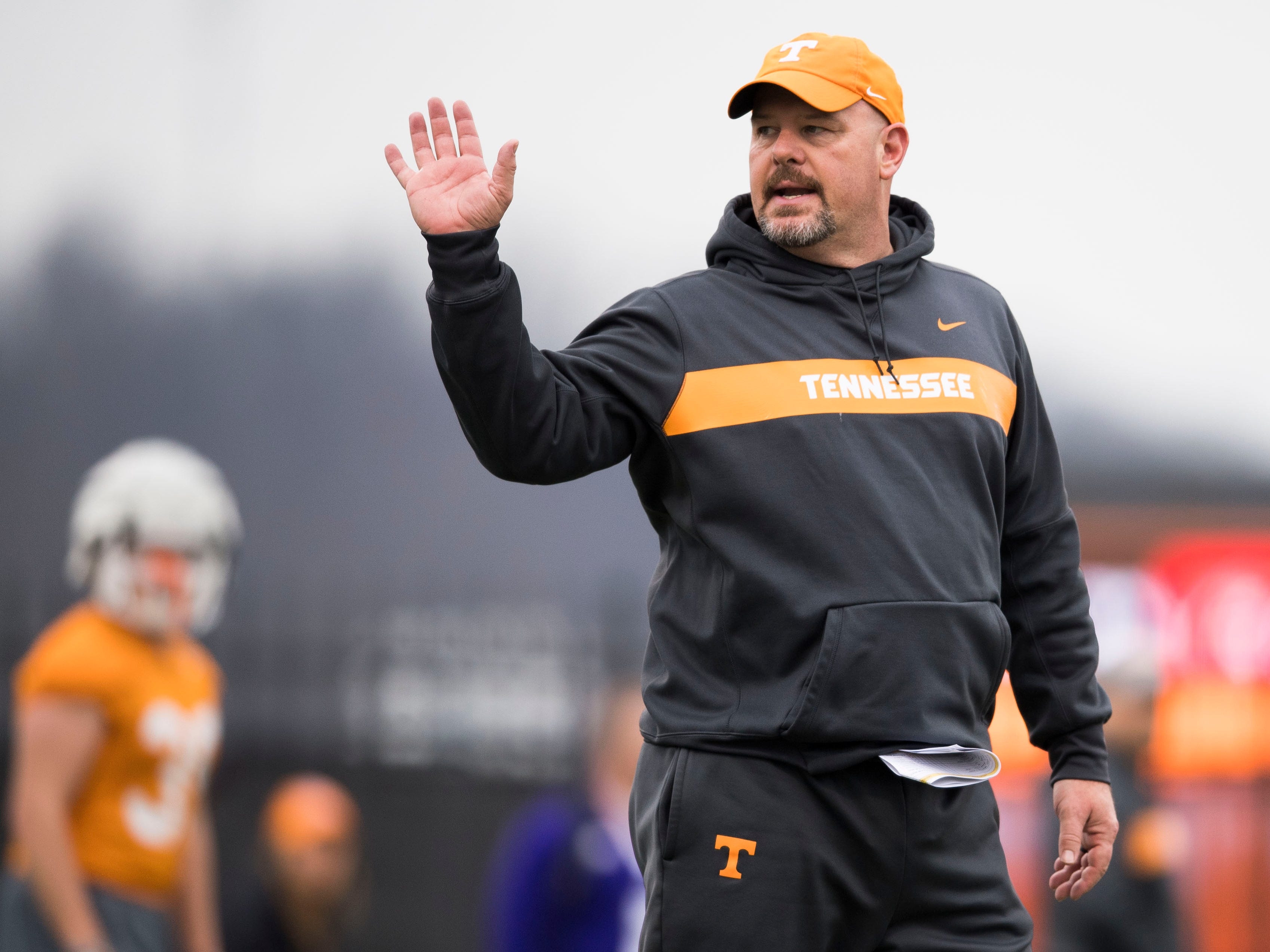 Tennessee offensive line coach Will Friend coaches during Tennessee football's first practice of the spring season at University of Tennessee Thursday, March 7, 2019.