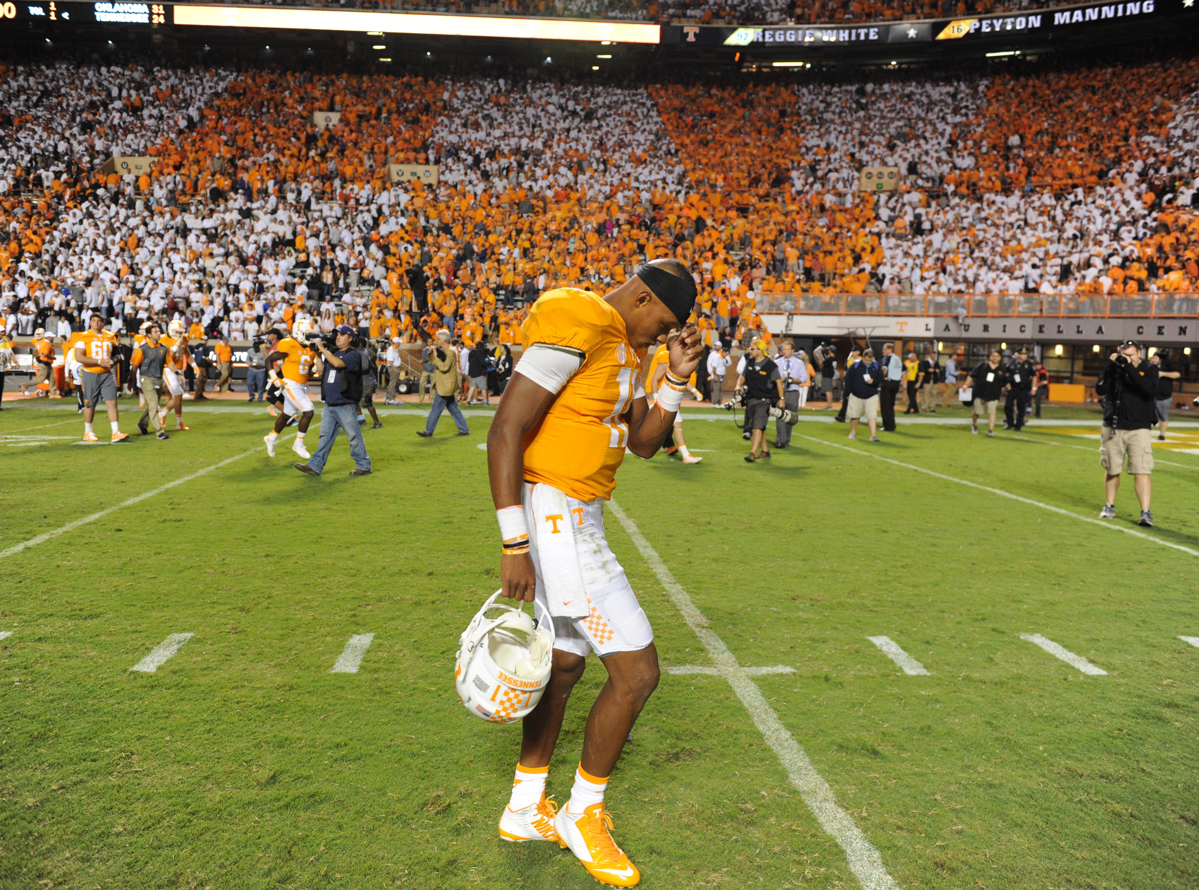 Tennessee quarterback Joshua Dobbs (11) walks off the field following their 31-24 loss to Oklahoma in Neyland Stadium Saturday, Sep. 12, 2015.