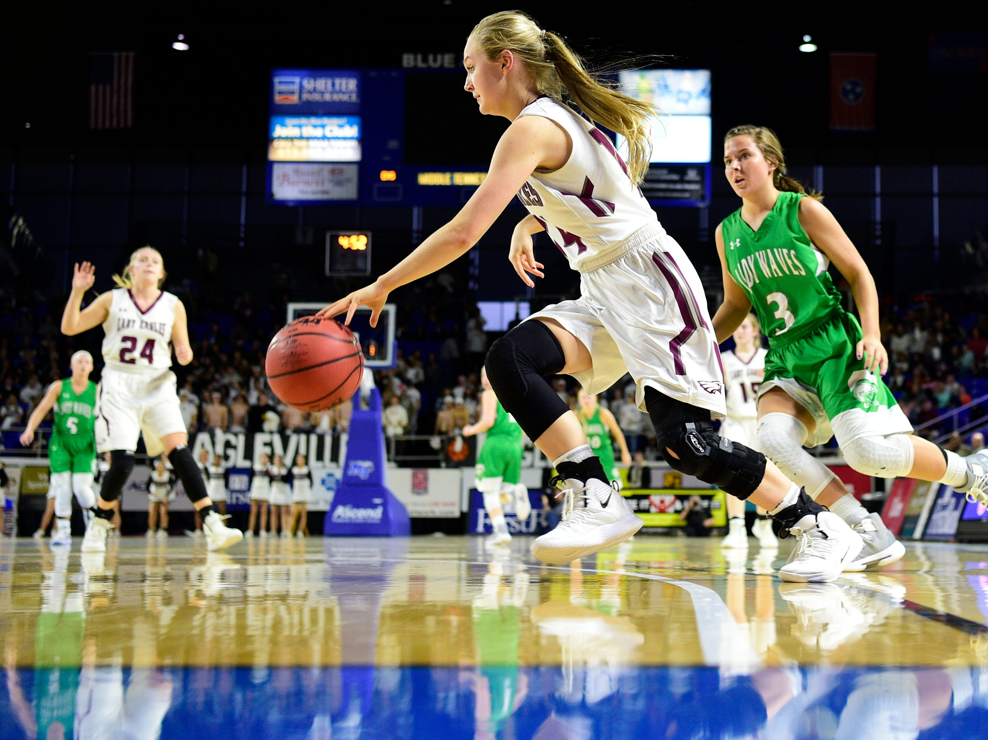 Eagleville's Anna Grace Clement (24) dribbles the ball down the court during a game between Eagleville and Midway at the TSSAA girls state tournament at the Murphy Center in Murfreesboro, Tennessee on Thursday, March 7, 2019.