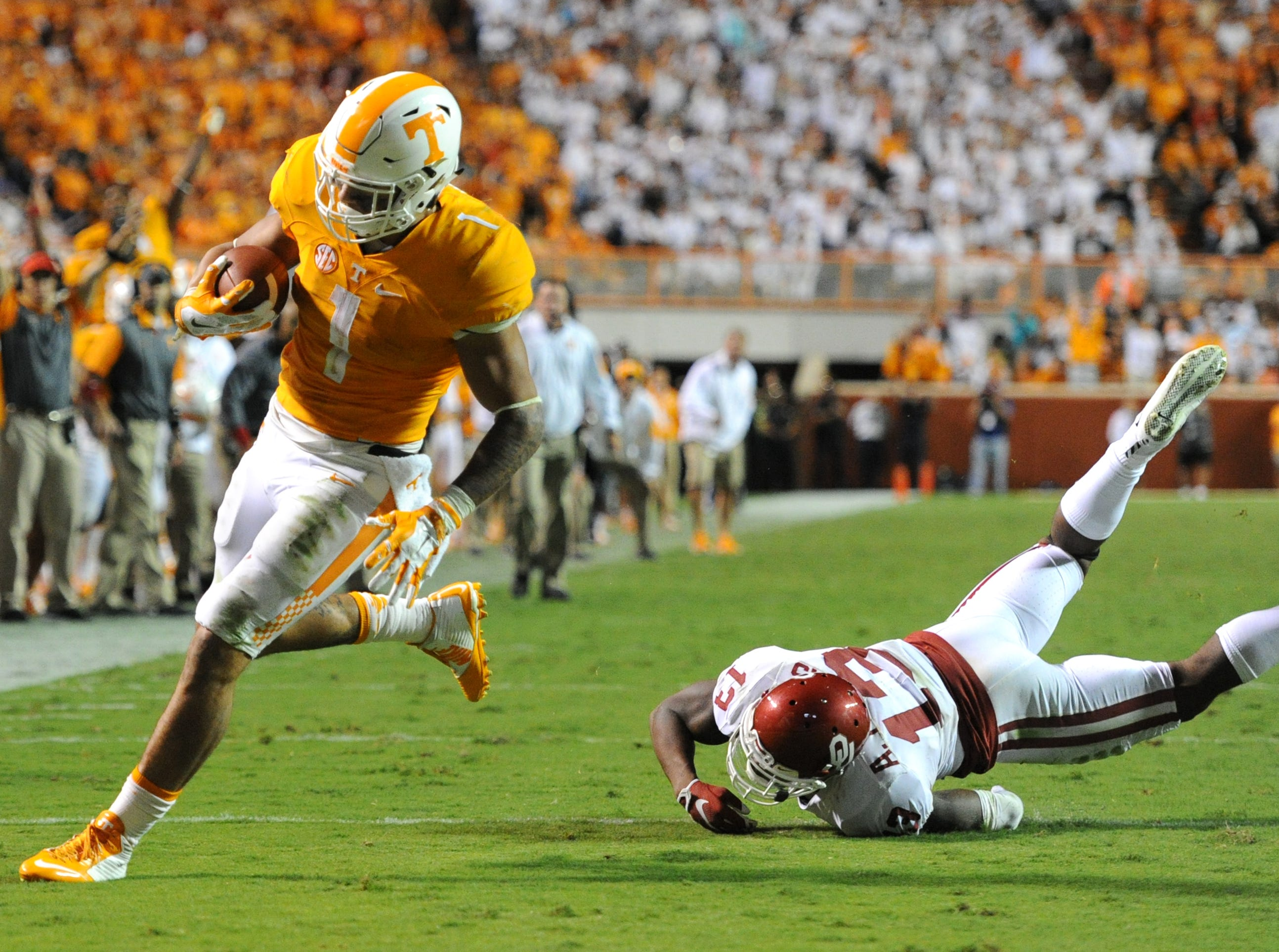 Tennessee running back Jalen Hurd (1) gets past Oklahoma safety Ahmad Thomas (13) to score an touchdown in the first overtime period at Neyland Stadium on Saturday, Sept. 12, 2015 in Knoxville, Tenn. Oklahoma won 31-24.