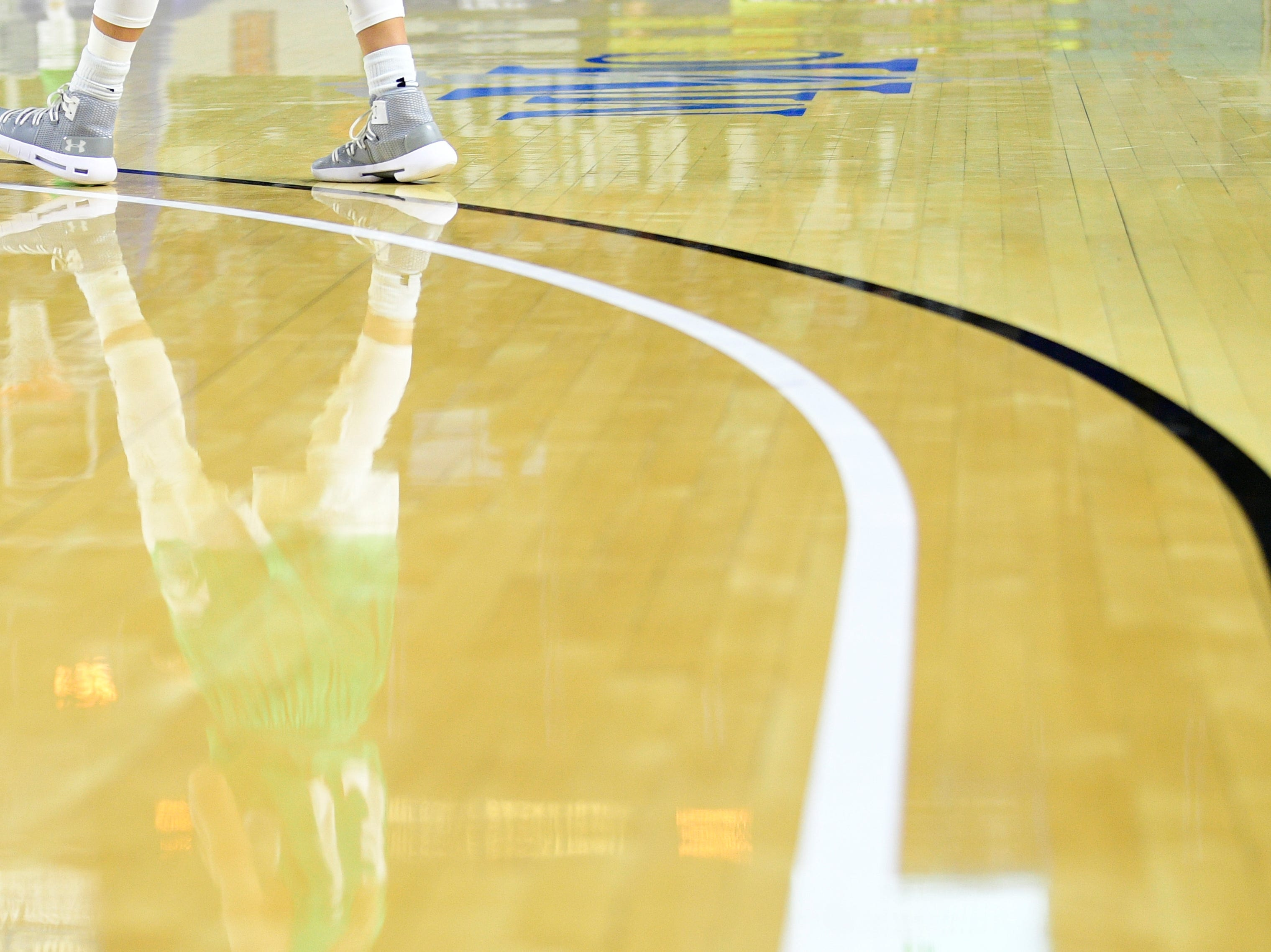 A player walks down the court during a game between Eagleville and Midway at the TSSAA girls state tournament at the Murphy Center in Murfreesboro, Tennessee on Thursday, March 7, 2019.