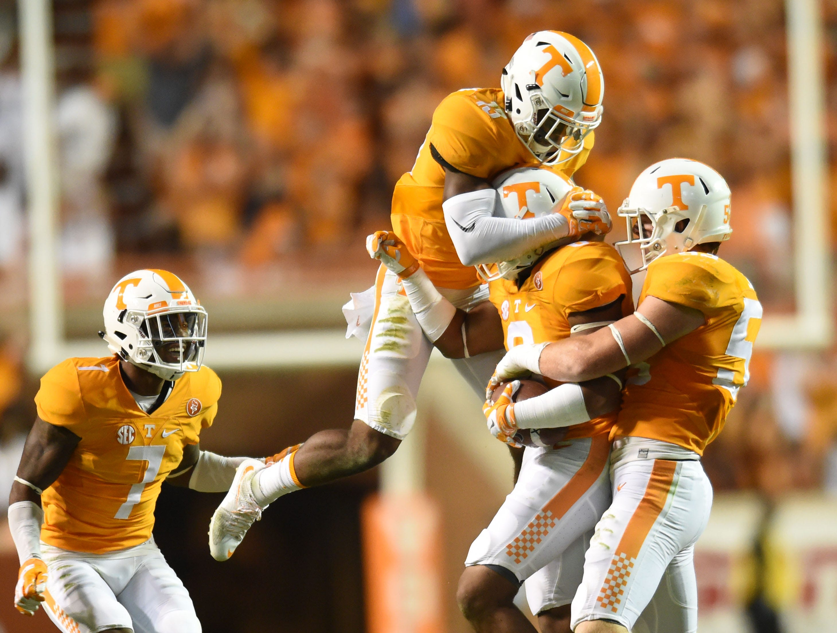 Tennessee defenders celebrate with Todd Kelly Jr. after an interception against Oklahoma during the second half at Neyland Stadium on Saturday, Sept. 12, 2015 in Knoxville, Tenn.