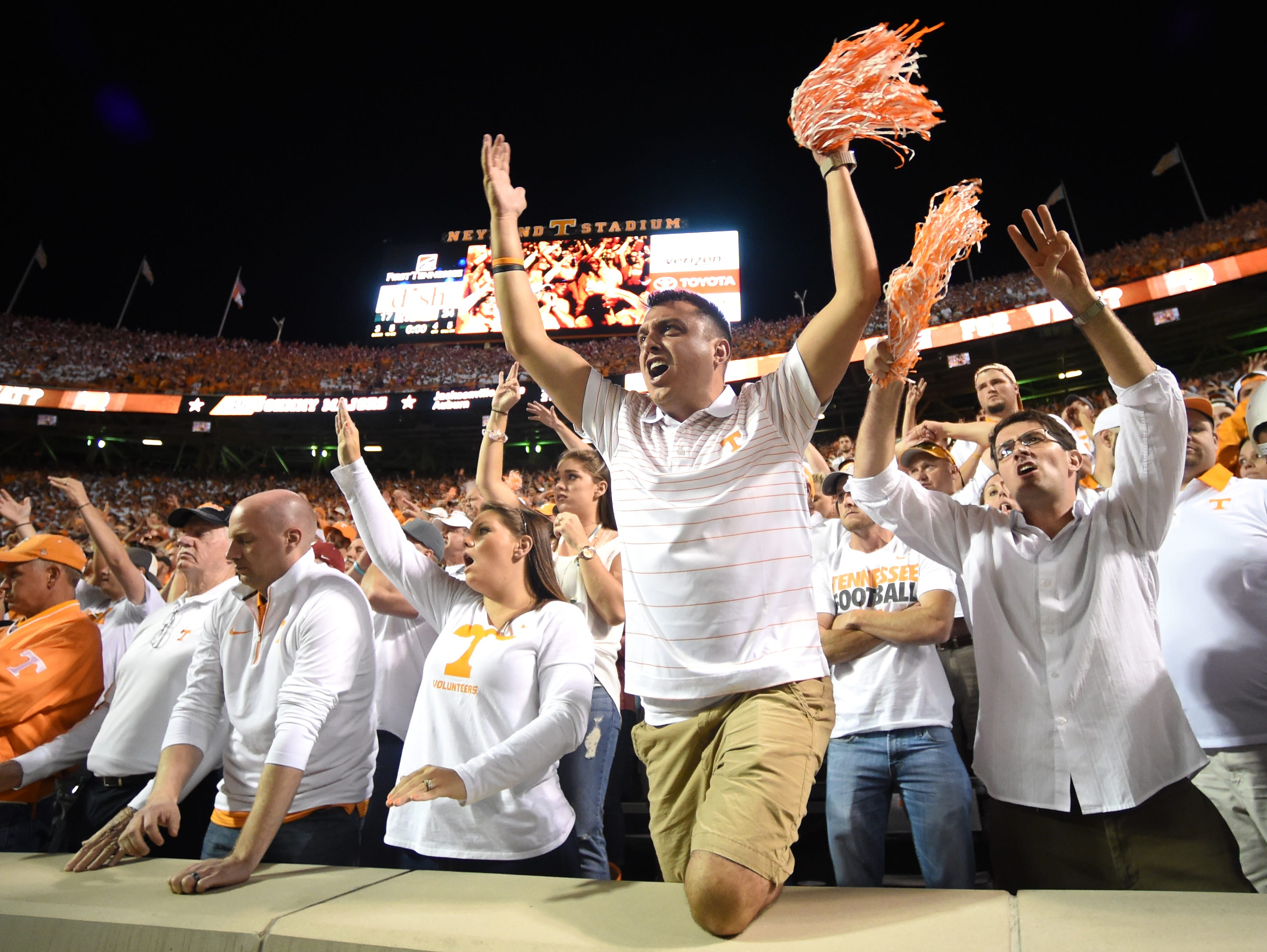 Tennessee fans cheer their team during overtime against Oklahoma at Neyland Stadium on Saturday, Sept. 12, 2015 in Knoxville, Tenn. Oklahoma won 31-24.