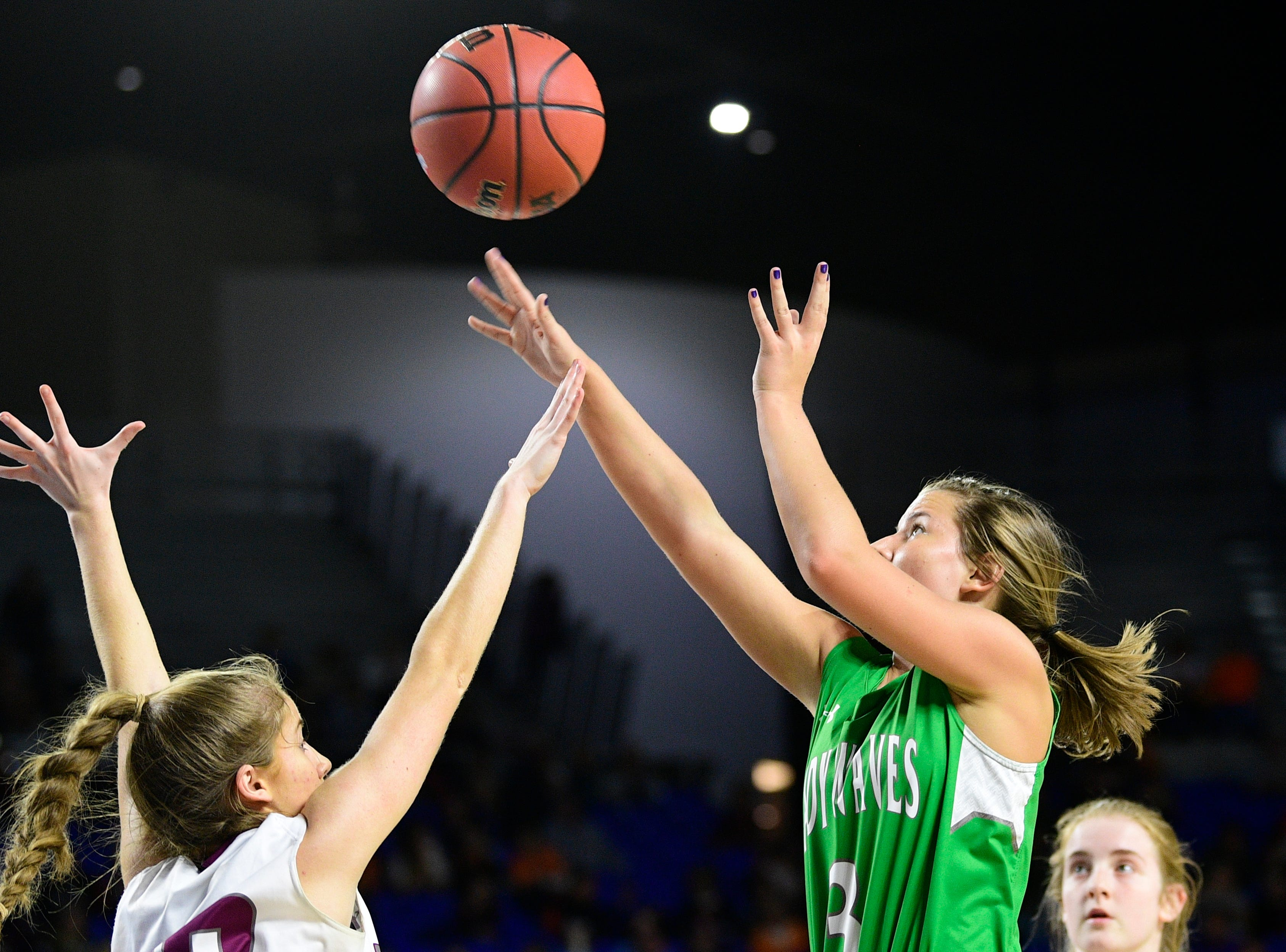 Midway's Rebecca Lemasters (3) shoots the ball during a game between Eagleville and Midway at the TSSAA girls state tournament at the Murphy Center in Murfreesboro, Tennessee on Thursday, March 7, 2019.