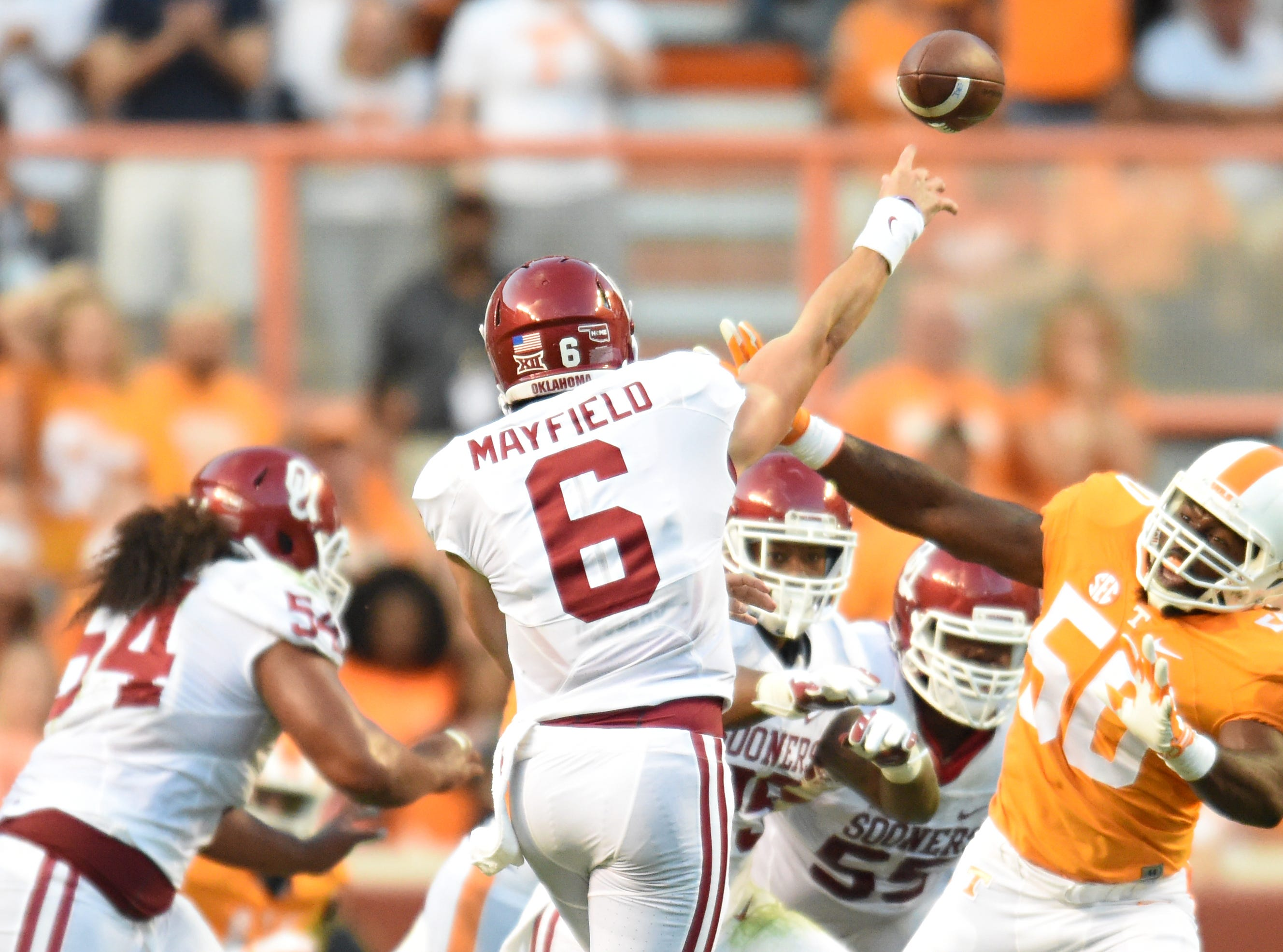 Oklahoma quarterback Baker Mayfield (6) passes under pressure from Tennessee defensive lineman Corey Vereen (50) during the first half at Neyland Stadium on Saturday, Sept. 12, 2015 in Knoxville, Tenn.