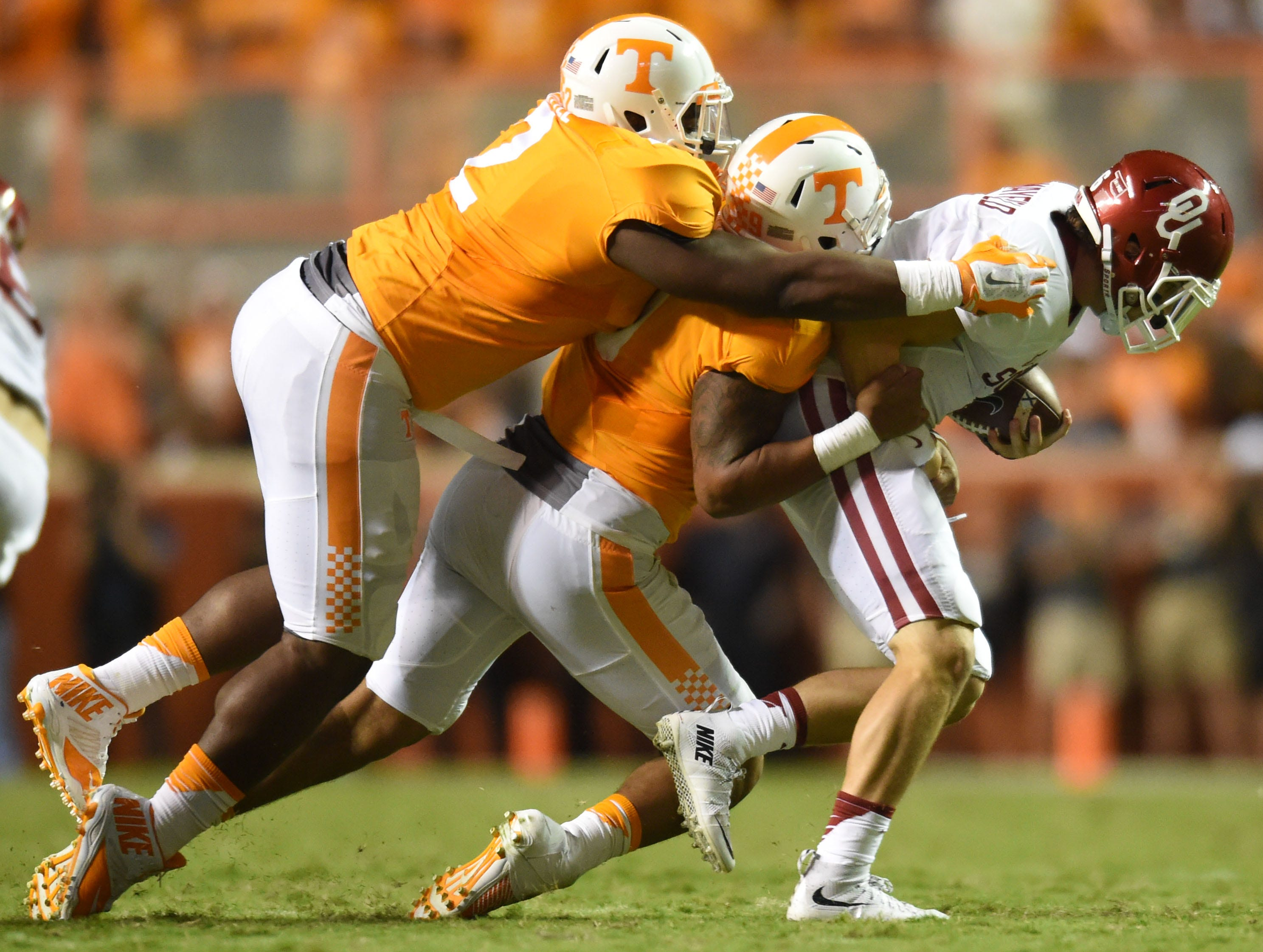 Tennessee defensive end Derek Barnett (9) and Tennessee defensive lineman Shy Tuttle (2) stop Oklahoma quarterback Baker Mayfield (6) during the second half at Neyland Stadium on Saturday, Sept. 12, 2015 in Knoxville, Tenn.
