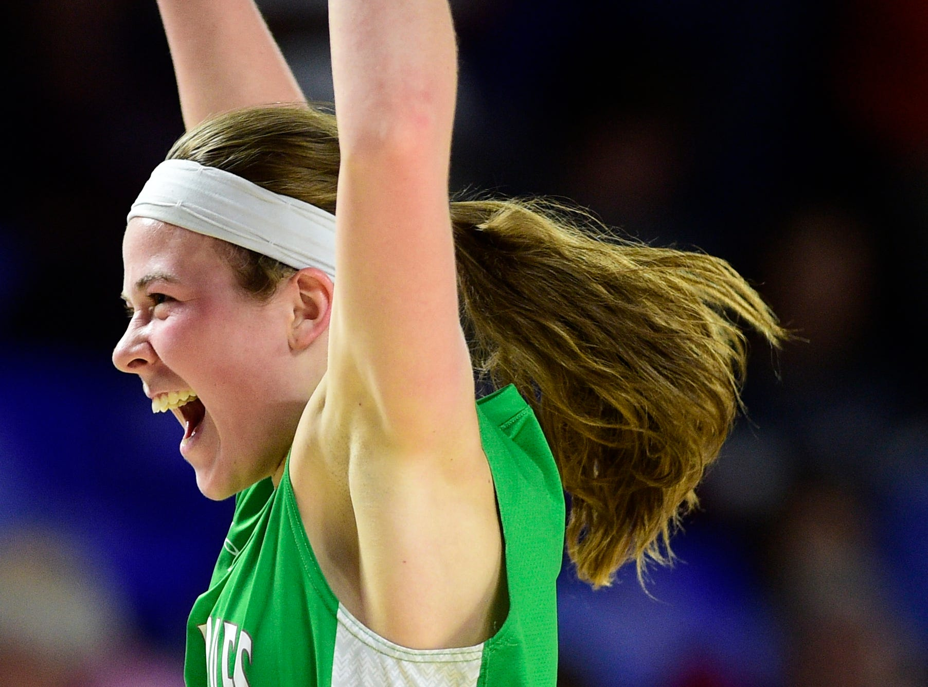 Midway's Caitlyn Ross (1) reacts after defeating Eagleville at the TSSAA girls state tournament at the Murphy Center in Murfreesboro, Tennessee on Thursday, March 7, 2019.