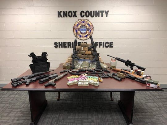 Authorities seized approximately 38 pounds of marijuana, 13 firearms, an unspecified amount of cash and other illicit items during a drug raid on a home at 8537 Old Rutledge Pike on Tuesday, March 5, 2019.