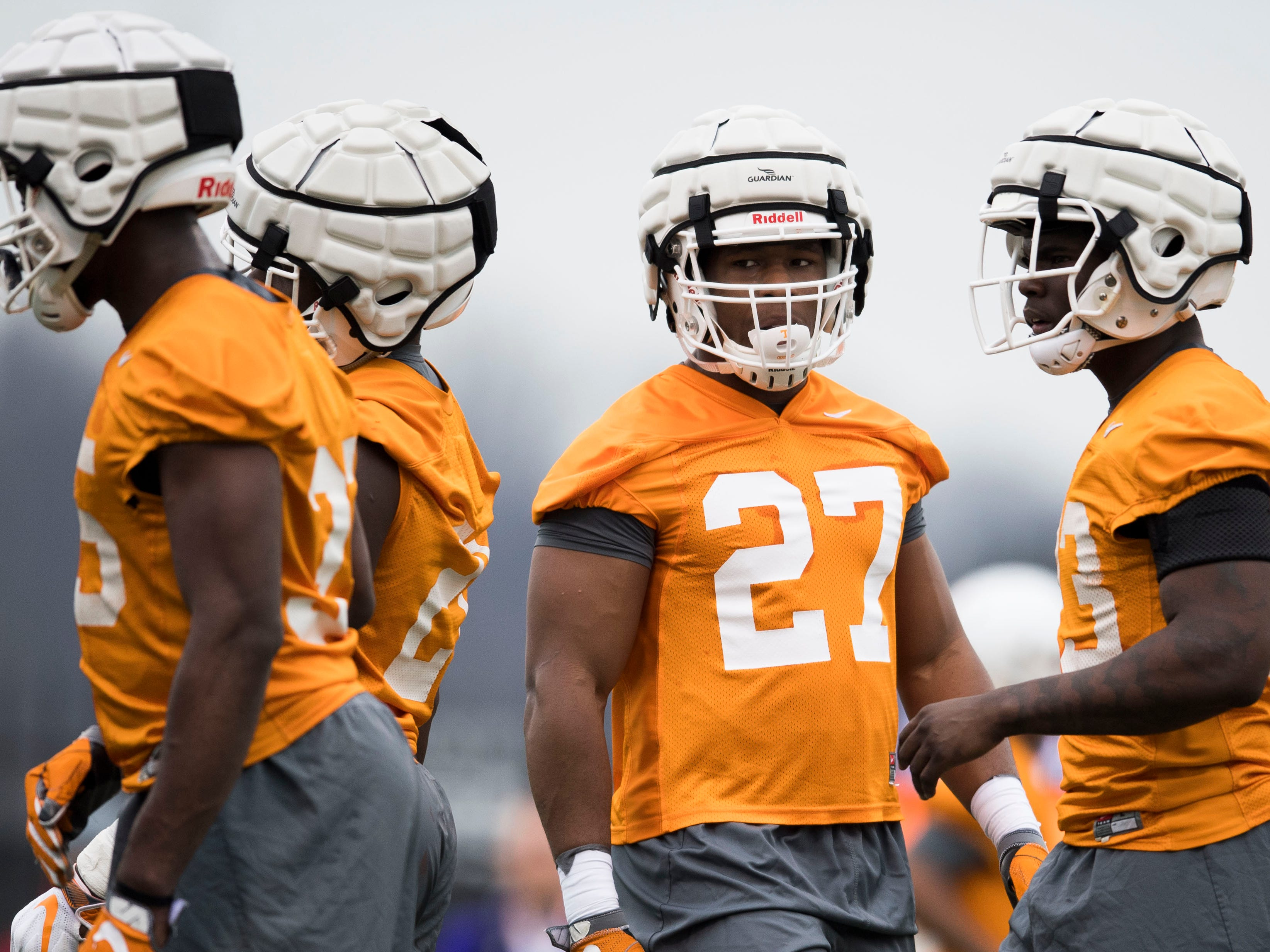 At center Tennessee's Quavaris Crouch (27) participates in a drill during Tennessee football's first practice of the spring season at University of Tennessee Thursday, March 7, 2019.