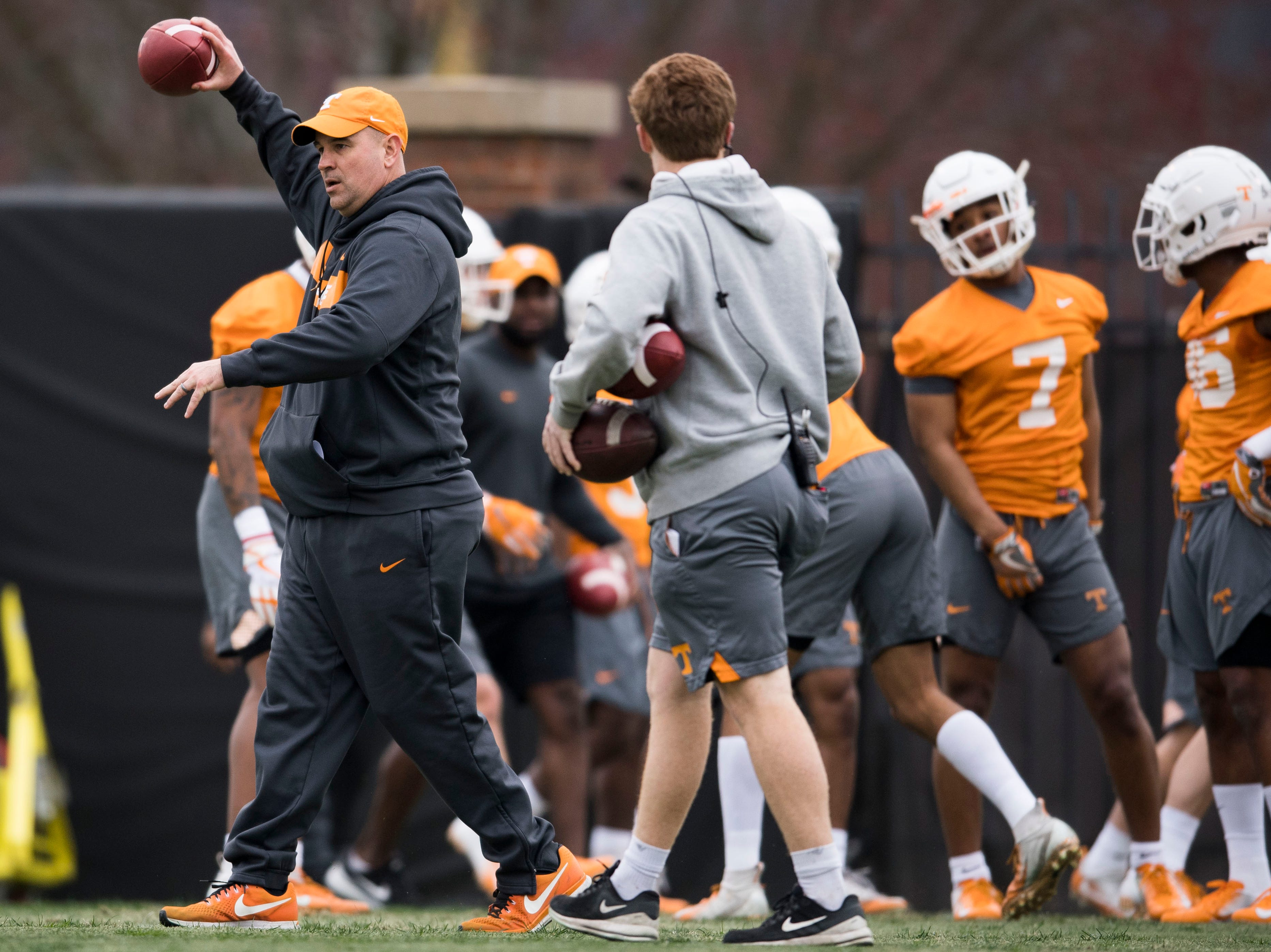 Tennessee head coach Jeremy Pruitt holds a ball during Tennessee football's first practice of the spring season at University of Tennessee Thursday, March 7, 2019.