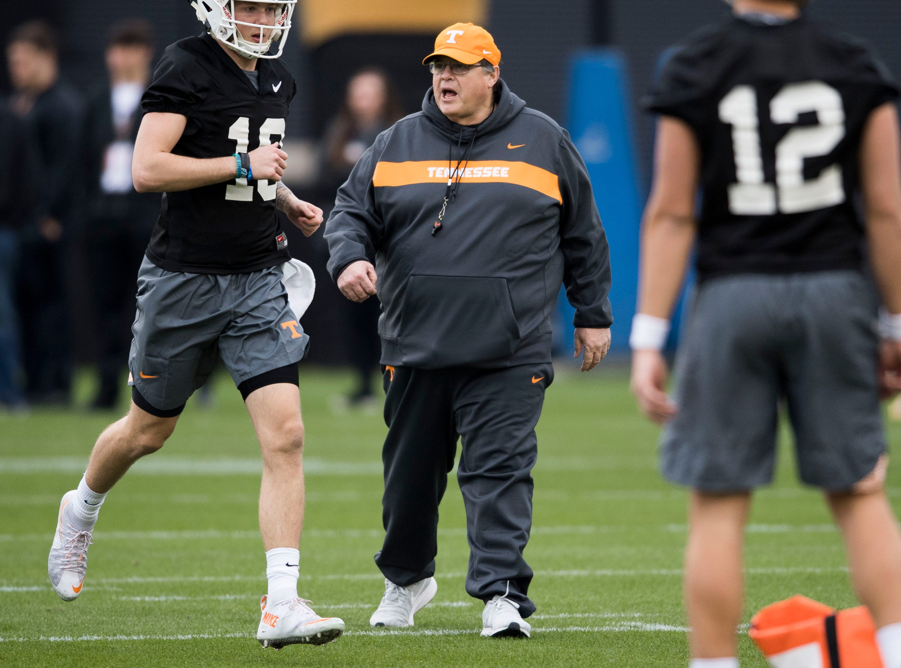 Tennessee offensive coordinator Jim Chaney walks on the field during Tennessee football's first practice of the spring season at University of Tennessee Thursday, March 7, 2019.