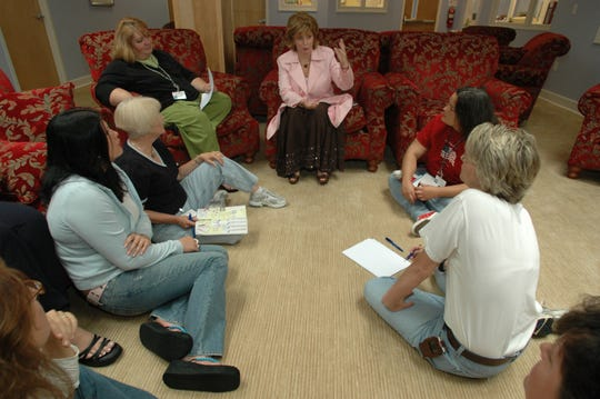 Jacqueline Dawes, center, talks with counselors at Brookhaven Retreat, several years prior. On Tuesday, Dawes abruptly closed the women-only addiction and mental-health facility.