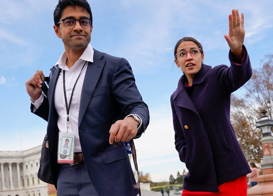 Rep. Alexandria Ocasio-Cortez, D-NY., right, and her chief of staff Saikat Chakrabarti, left, walk back together after joining other members of the freshman class of Congress for a group photo on Capitol Hill in Washington, Wednesday, Nov. 14, 2018.
