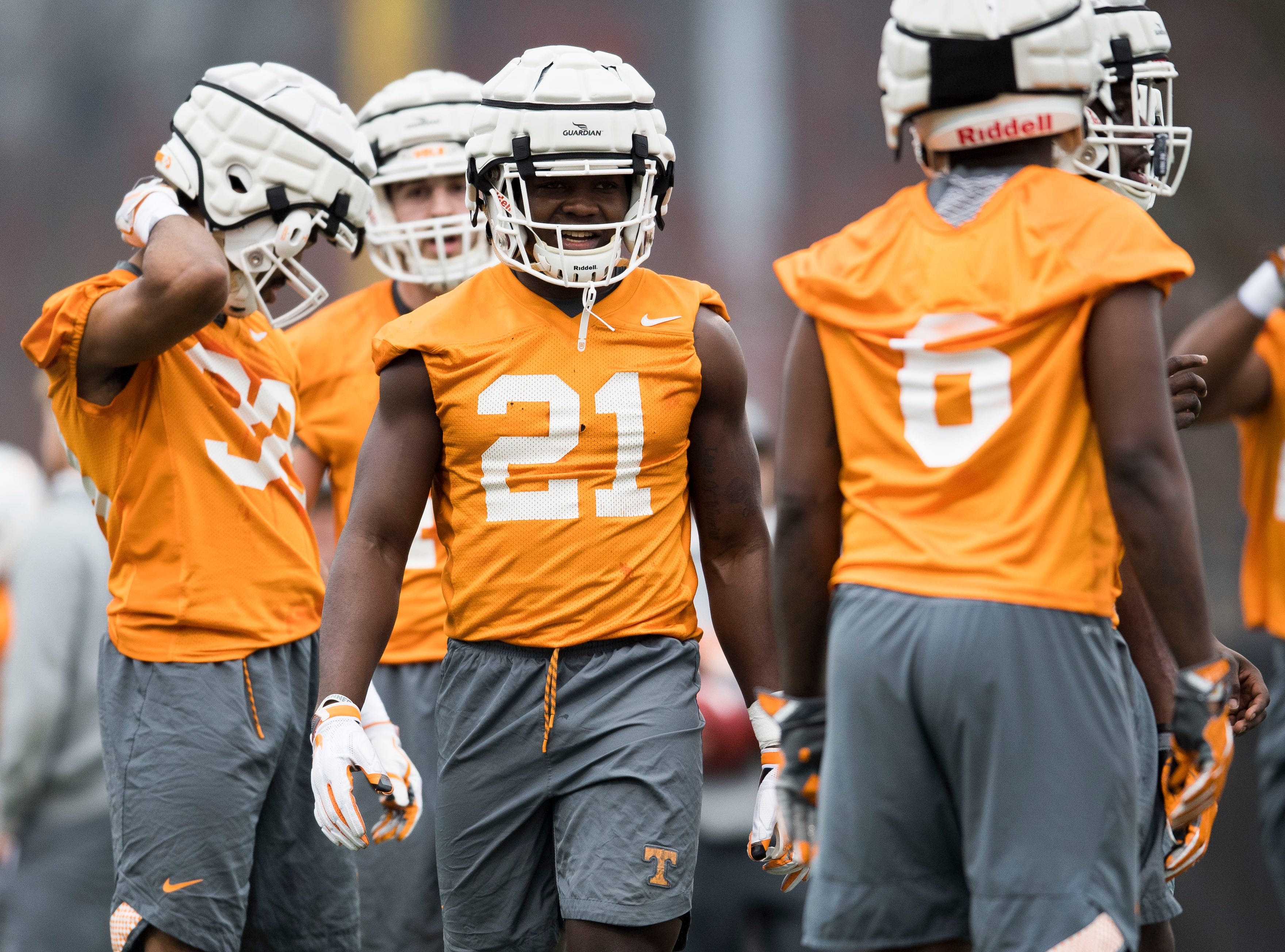 Tennessee players walk on the field during Tennessee football's first practice of the spring season at University of Tennessee Thursday, March 7, 2019.