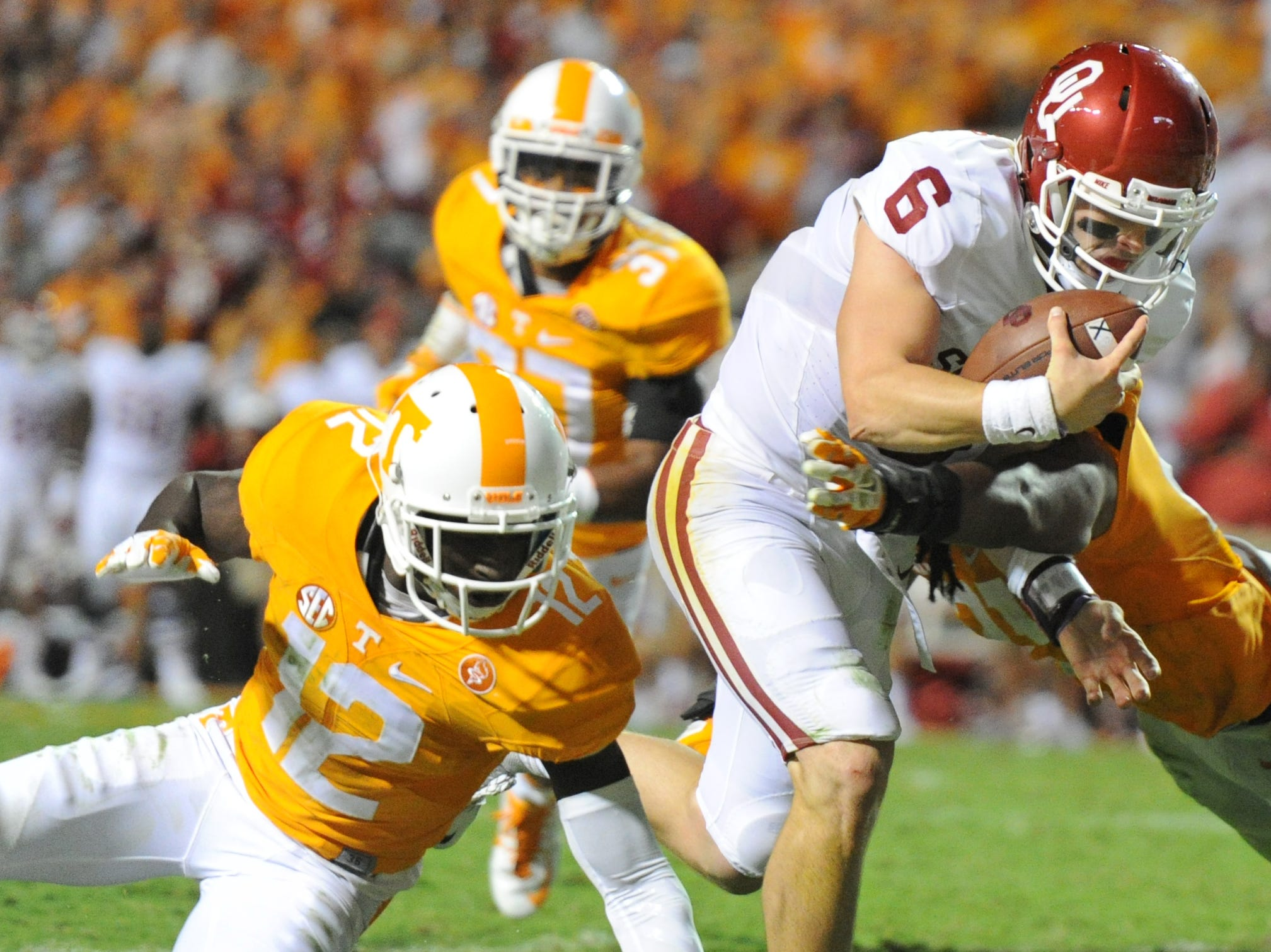 Oklahoma quarterback Baker Mayfield (6) beats a tackle by Tennessee defensive back Emmanuel Moseley (12) to score a touchdown in the first overtime period at Neyland Stadium on Saturday, Sept. 12, 2015 in Knoxville, Tenn. Oklahoma won 31-24.