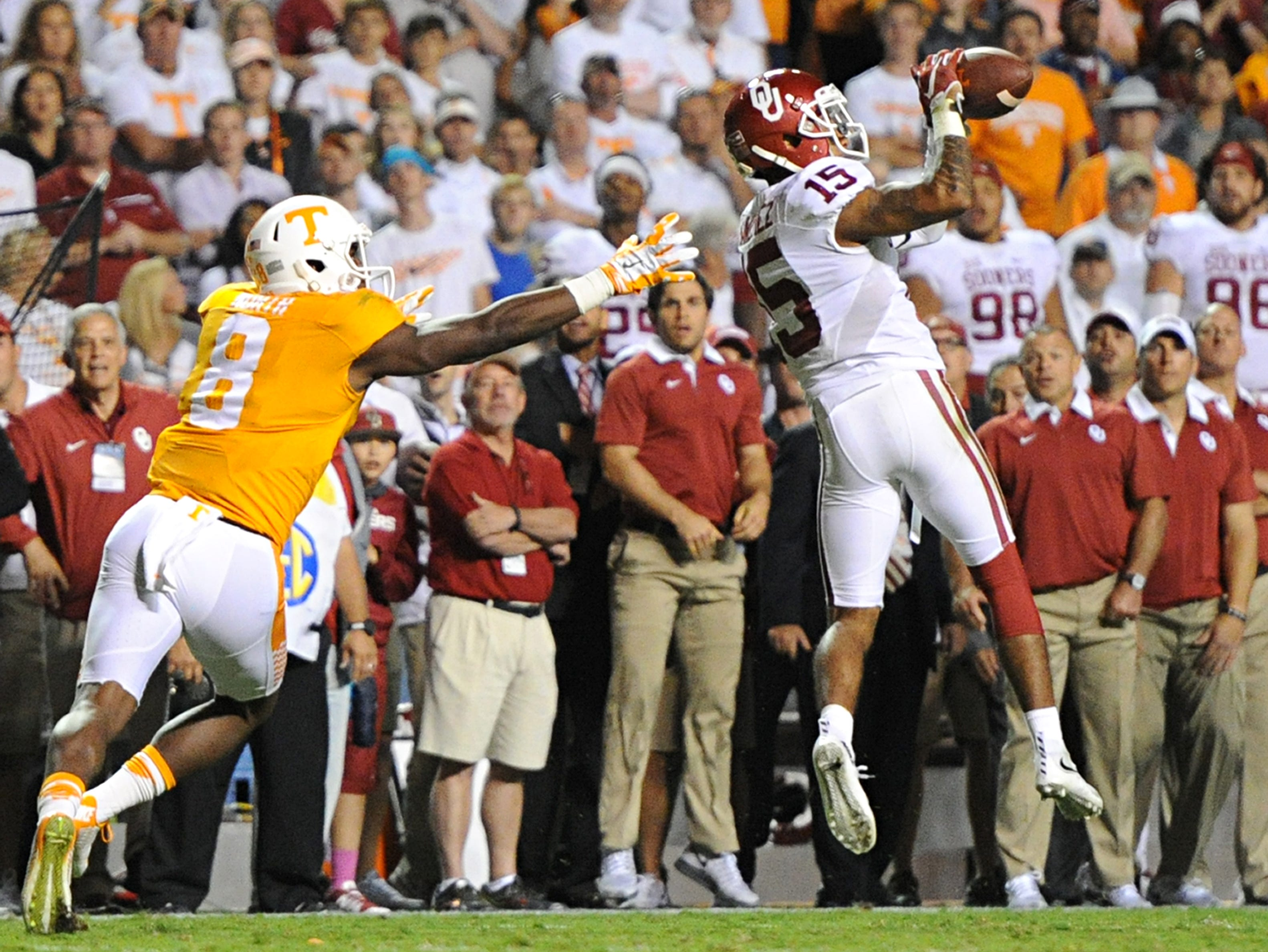 Oklahoma cornerback Zack Sanchez (15) intercepts a pass intended for Tennessee wide receiver Marquez North (8) in the second overtime period to clinch Oklahoma's 31-24 victory over Tennessee at Neyland Stadium on Saturday, Sept. 12, 2015 in Knoxville, Tenn.
