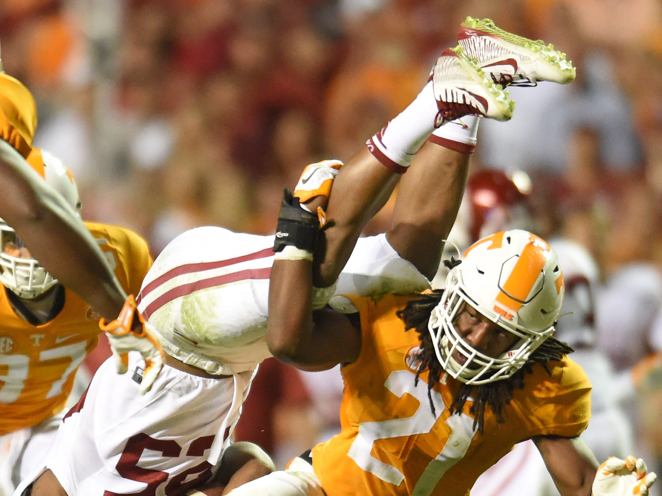 Tennessee linebacker Jalen Reeves-Maybin (21) upends Oklahoma running back Joe Mixon (25) during the second half at Neyland Stadium on Saturday, Sept. 12, 2015 in Knoxville, Tenn.
