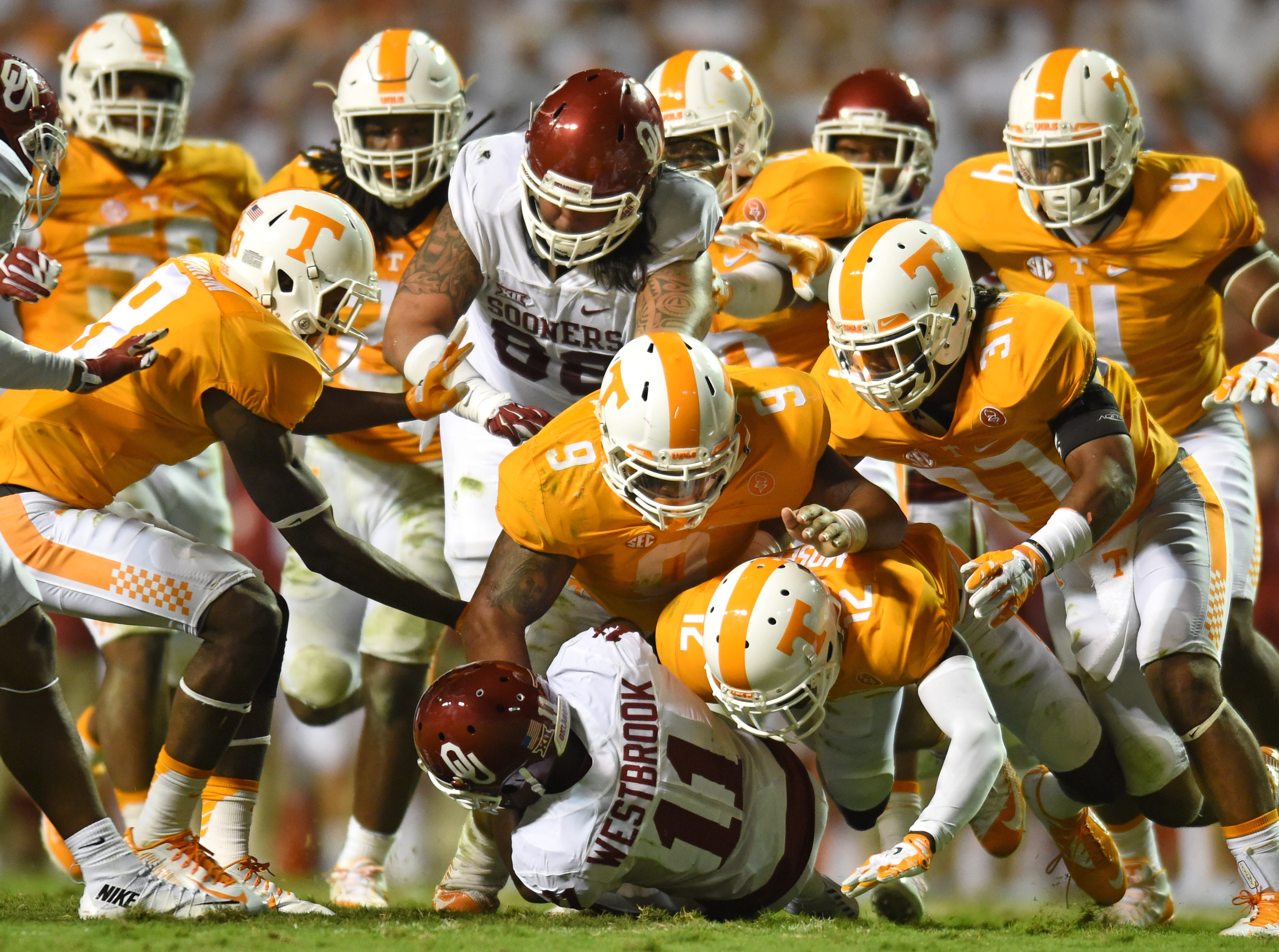 Tennessee defense swarms onto Oklahoma wide receiver Dede Westbrook (11) during the second half at Neyland Stadium on Saturday, Sept. 12, 2015 in Knoxville, Tenn. Oklahoma won 31-24.