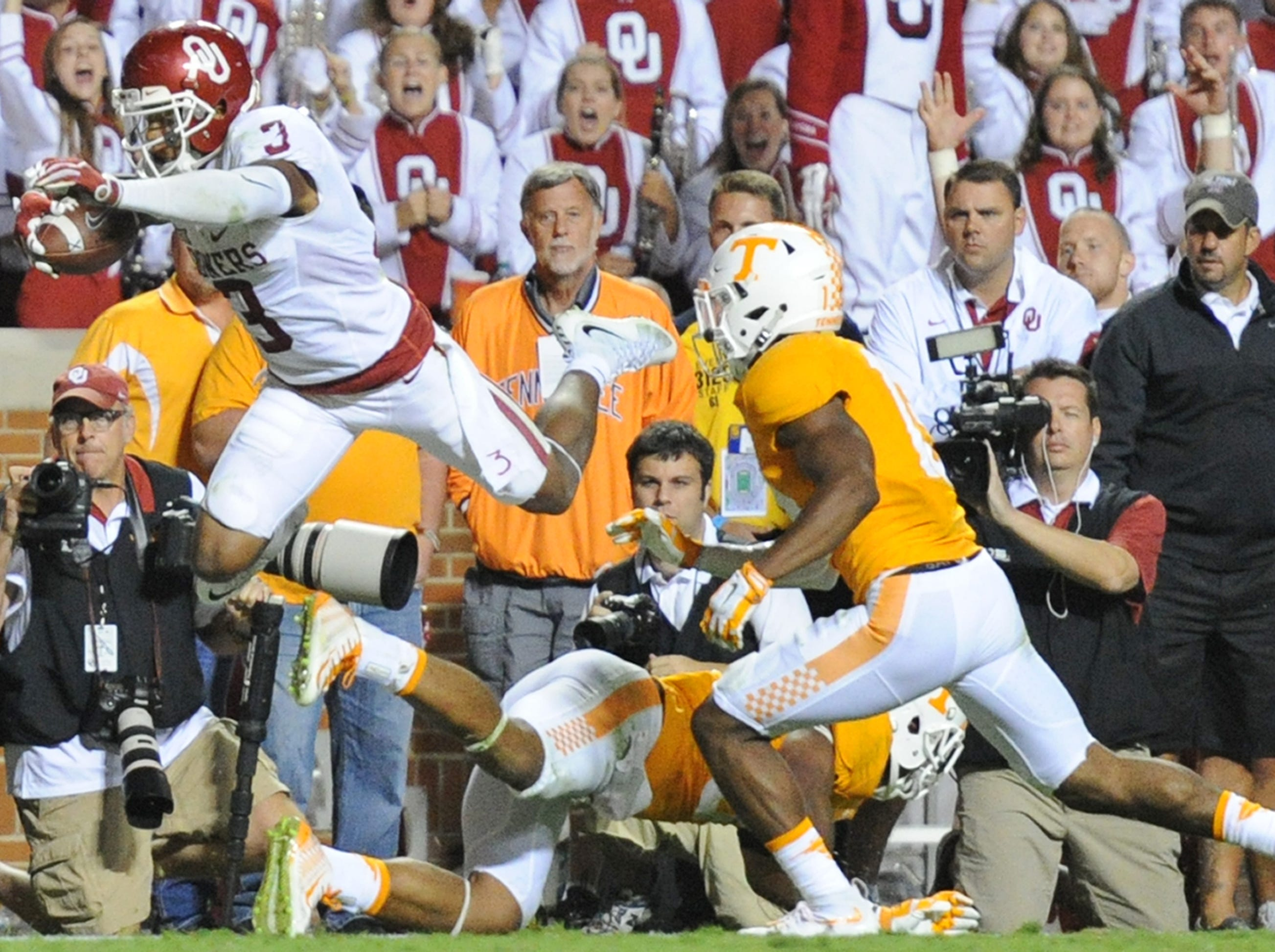 Oklahoma wide receiver Sterling Shepard (3) leaps past Tennessee defensive back Brian Randolph (37) for the game-winning touchdown in overtime against Tennessee at Neyland Stadium on Saturday, Sept. 12, 2015 in Knoxville, Tenn. Oklahoma won 31-24.