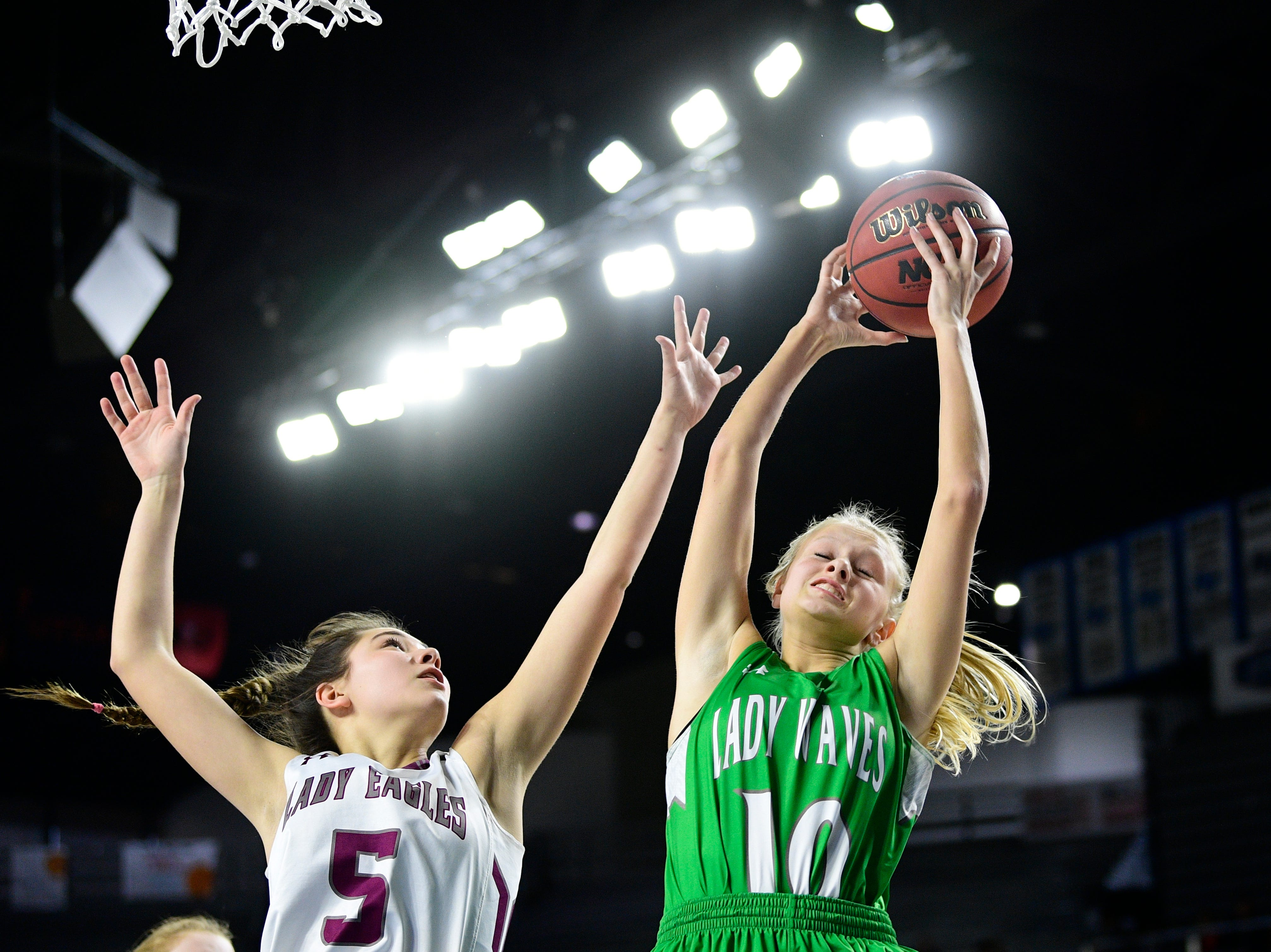 Midway's Heaven Prinzi (10) grabs the rebound past Eagleville's Elizabeth Thompson (5) during a game between Eagleville and Midway at the TSSAA girls state tournament at the Murphy Center in Murfreesboro, Tennessee on Thursday, March 7, 2019.