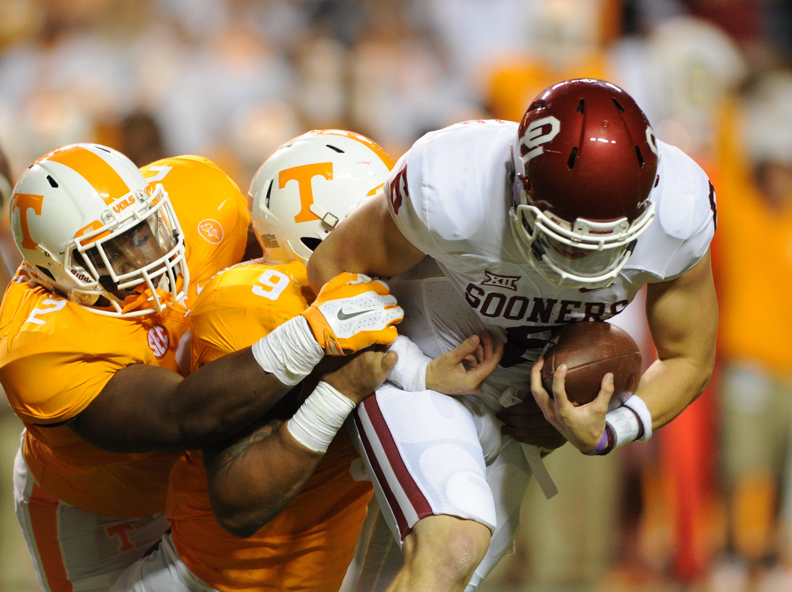 Tennessee defensive lineman Shy Tuttle (2) and defensive end Derek Barnett (9) sack Oklahoma quarterback Baker Mayfield during the second half at Neyland Stadium on Saturday, Sept. 12, 2015 in Knoxville, Tenn.