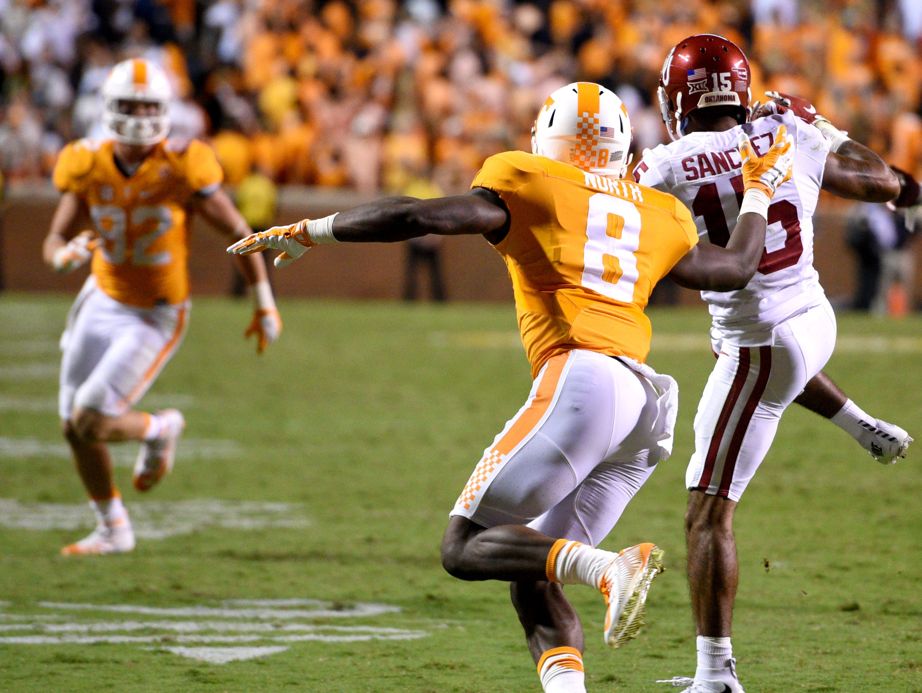 Oklahoma cornerback Zack Sanchez (15) intercepts a pass meant for Tennessee wide receiver Marquez North (8) in overtime, ending the game 31-24 on Saturday, Sept. 12, 2015 in Knoxville, Tenn.