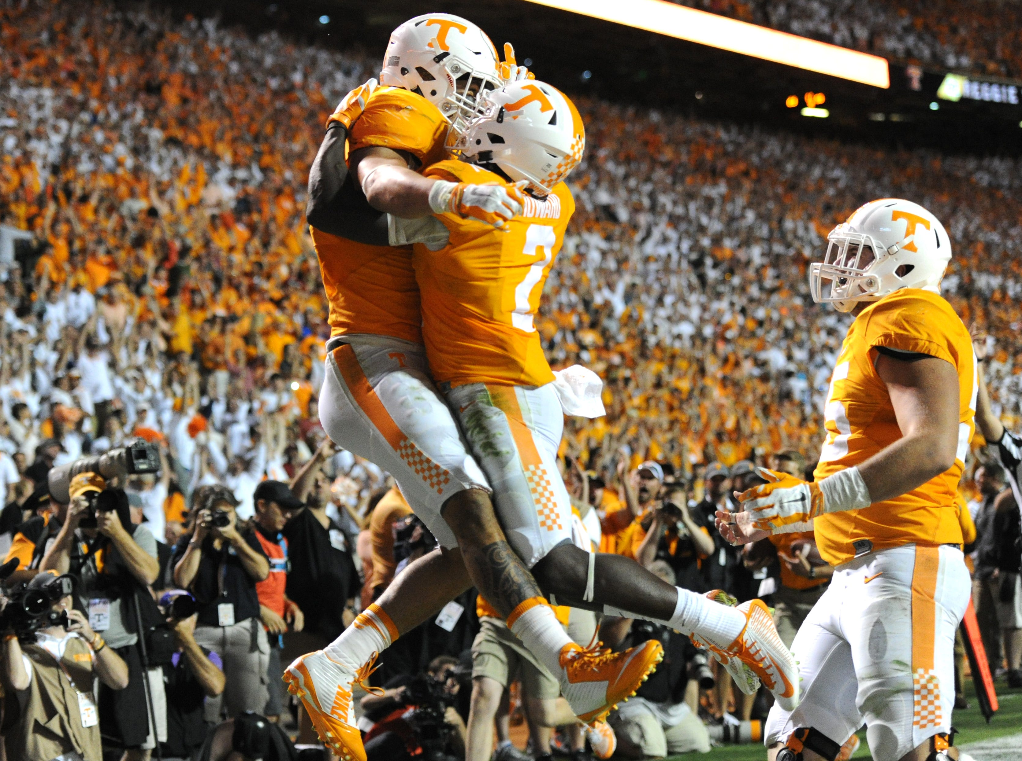 Tennessee running back Jalen Hurd (1) and Tennessee wide receiver Pig Howard (2) celebrate after Hurd beat Oklahoma safety Ahmad Thomas (13) for a touchdown in the first overtime period at Neyland Stadium on Saturday, Sept. 12, 2015 in Knoxville, Tenn. Oklahoma won 31-24.