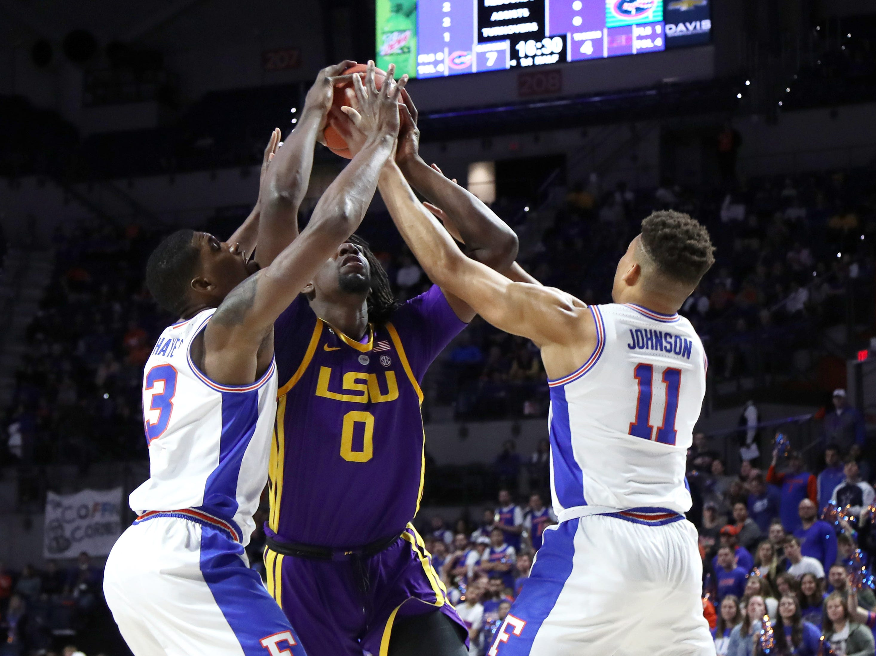 Mar 6, 2019; Gainesville, FL, USA; Florida Gators guard Jalen Hudson (3) and forward Keyontae Johnson (11) double team LSU Tigers forward Naz Reid (0) during the first half at Exactech Arena. Mandatory Credit: Kim Klement-USA TODAY Sports
