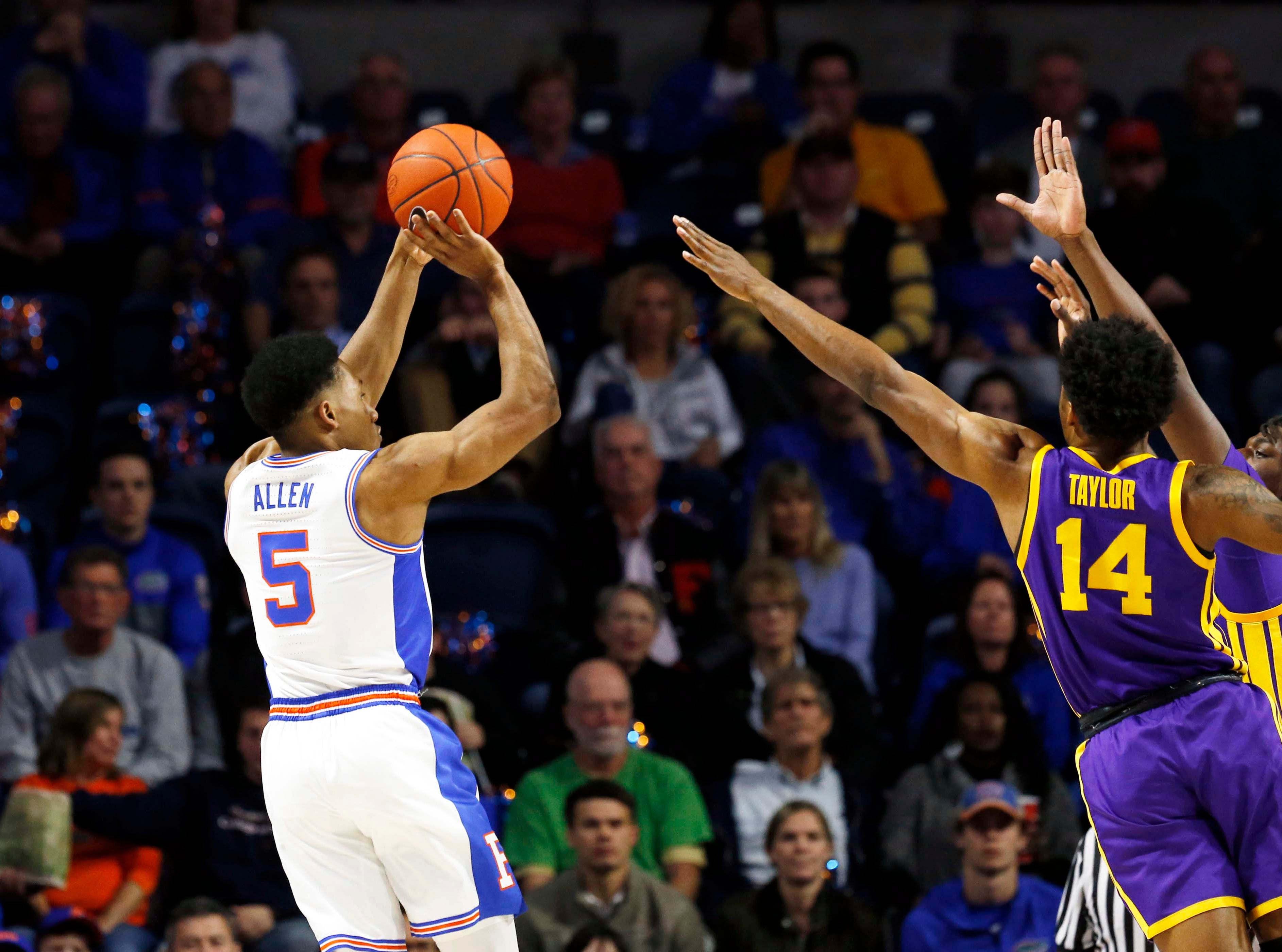 Mar 6, 2019; Gainesville, FL, USA; Florida Gators guard KeVaughn Allen (5) shoots over LSU Tigers guard Marlon Taylor (14) during the first half at Exactech Arena. Mandatory Credit: Kim Klement-USA TODAY Sports