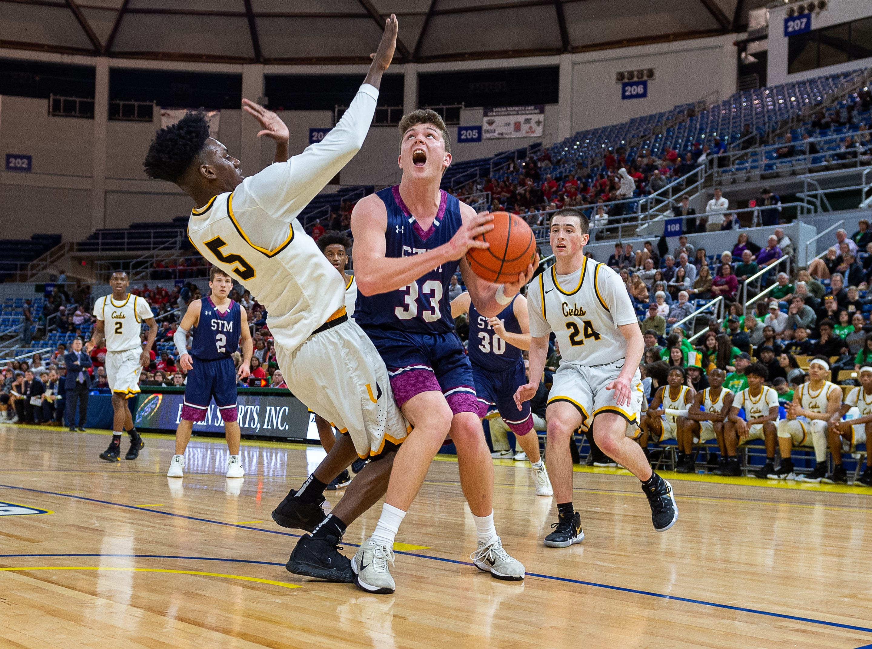 Caleb Holstein looks to shoot as STM takes down University High in the semi final round of the LHSAA Basketball State Championships. Wednesday, March 6, 2019.