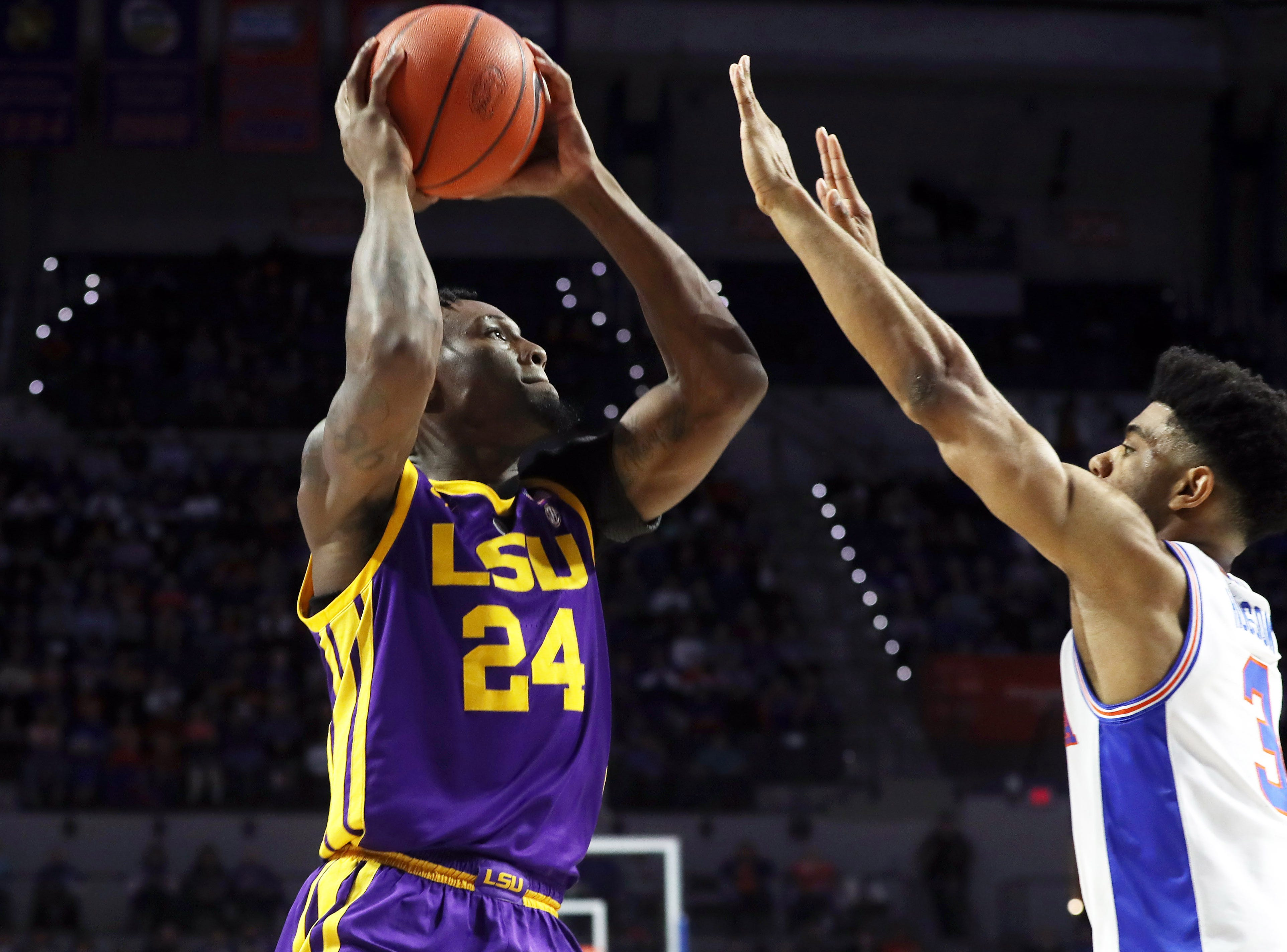 Mar 6, 2019; Gainesville, FL, USA; LSU Tigers forward Emmitt Williams (24) shoots the ball over Florida Gators guard Jalen Hudson (3) during the first half at Exactech Arena. Mandatory Credit: Kim Klement-USA TODAY Sports