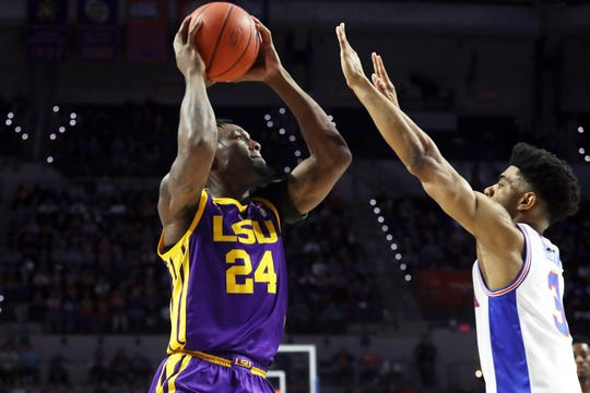 LSU Tigers forward Emmitt Williams shoots over Florida Gators guard Jalen Hudson during the first half at Exactech Arena in Gainesville on March 6.