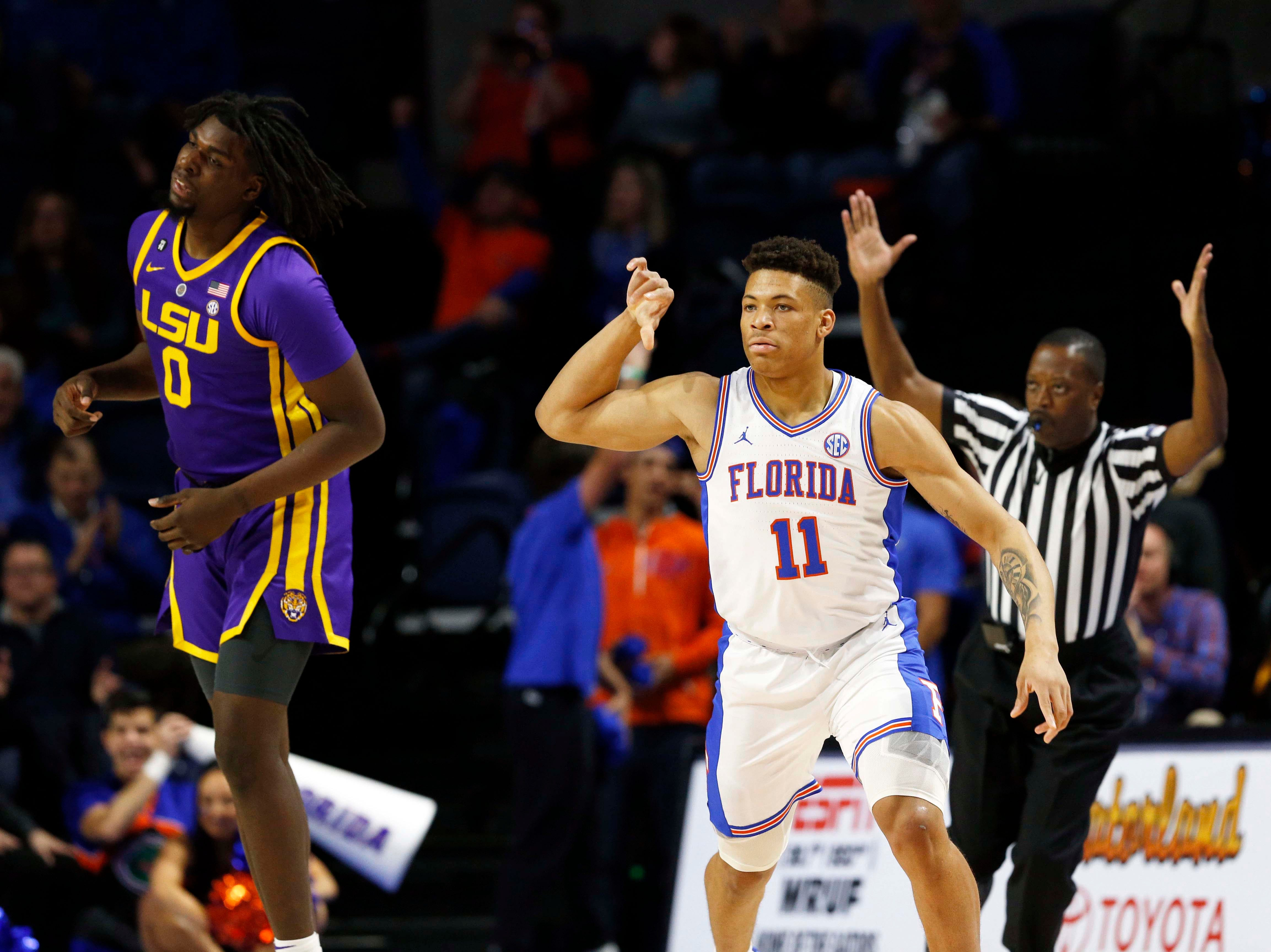 Mar 6, 2019; Gainesville, FL, USA; Florida Gators forward Keyontae Johnson (11) celebrates as he makes a three pointer against the LSU Tigers during the first half at Exactech Arena. Mandatory Credit: Kim Klement-USA TODAY Sports