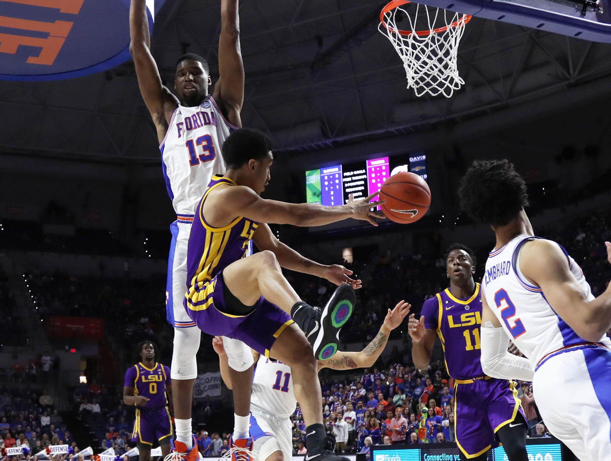 Mar 6, 2019; Gainesville, FL, USA; Florida Gators center Kevarrius Hayes (13) defends LSU Tigers guard Tremont Waters (3) during the first half at Exactech Arena. Mandatory Credit: Kim Klement-USA TODAY Sports