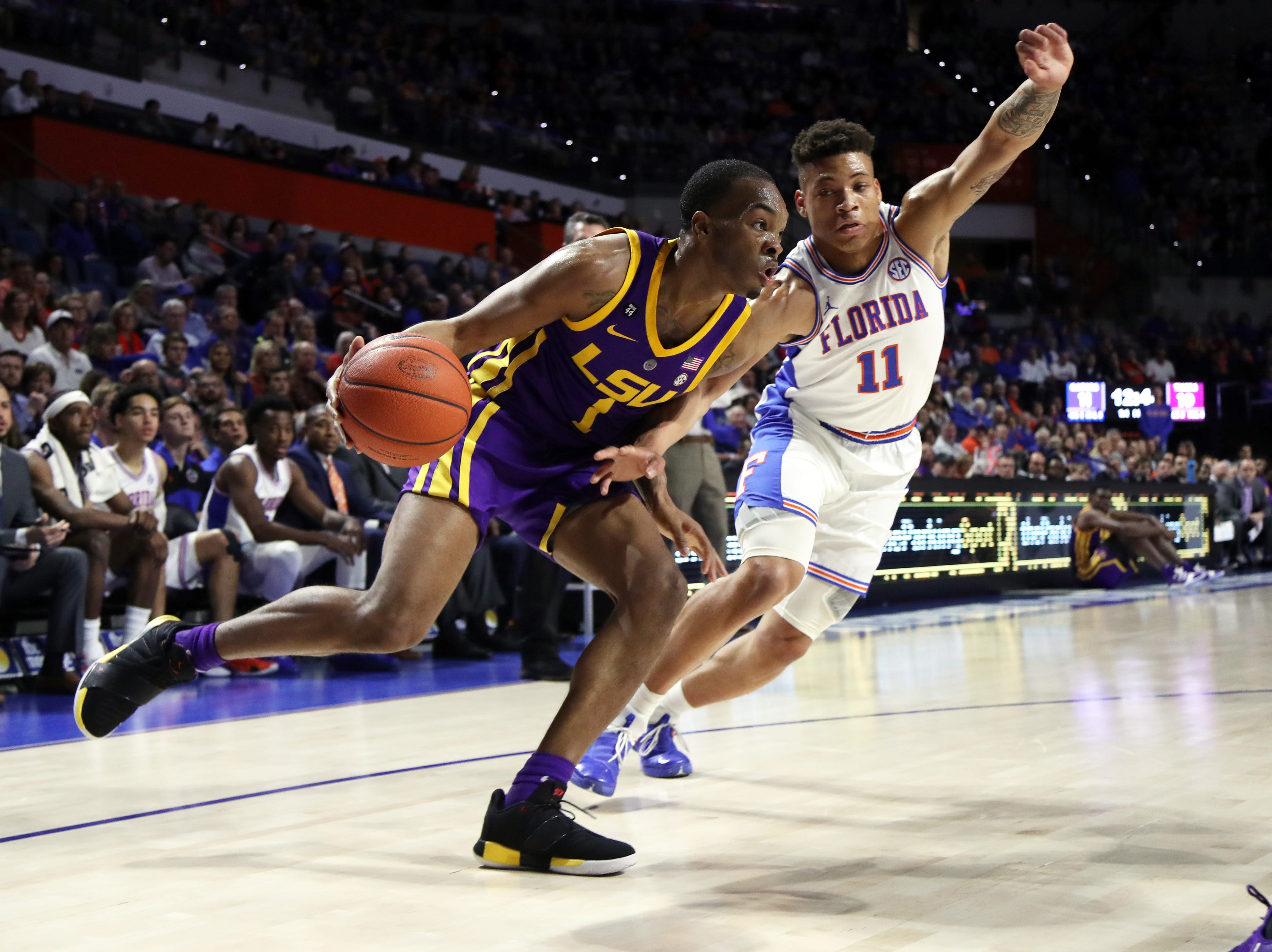 Mar 6, 2019; Gainesville, FL, USA; LSU Tigers guard Javonte Smart (1) drives to the basket as Florida Gators forward Keyontae Johnson (11) defends during the first half at Exactech Arena. Mandatory Credit: Kim Klement-USA TODAY Sports