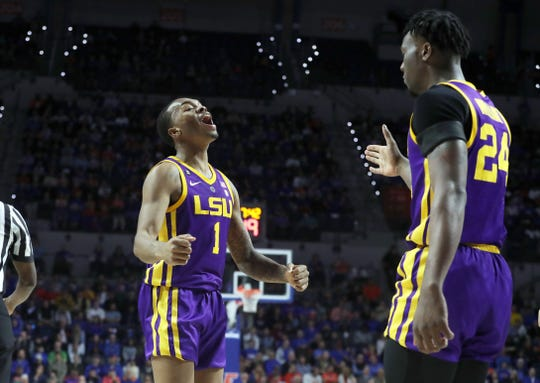 Mar 6, 2019; Gainesville, FL, USA;LSU Tigers guard Javonte Smart (1) celebrates with forward Emmitt Williams (24) against the Florida Gators  during the first half at Exactech Arena. Mandatory Credit: Kim Klement-USA TODAY Sports