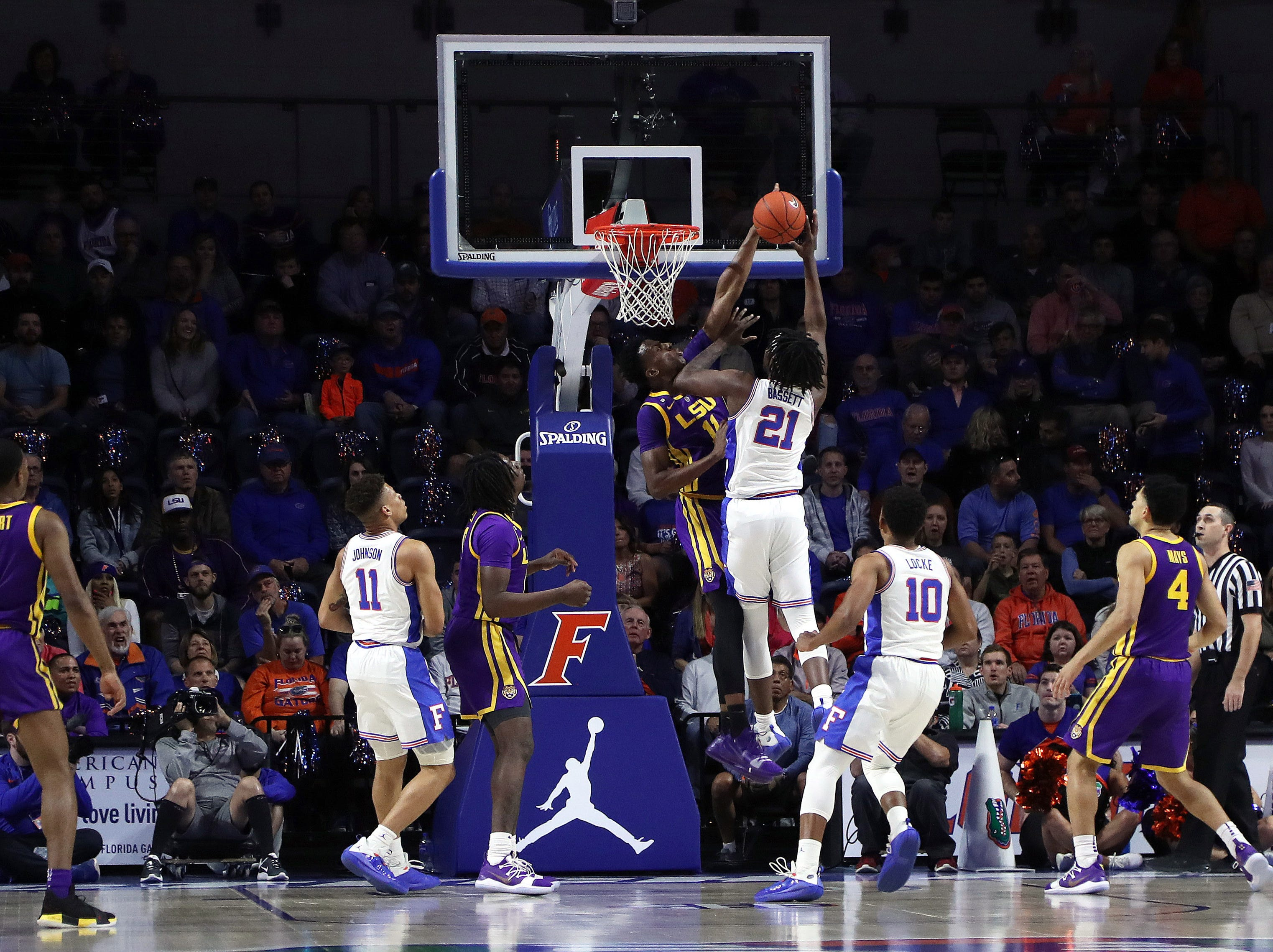 Mar 6, 2019; Gainesville, FL, USA; LSU Tigers forward Kavell Bigby-Williams (11) blocks Florida Gators forward Dontay Bassett (21) shot during the first half at Exactech Arena. Mandatory Credit: Kim Klement-USA TODAY Sports