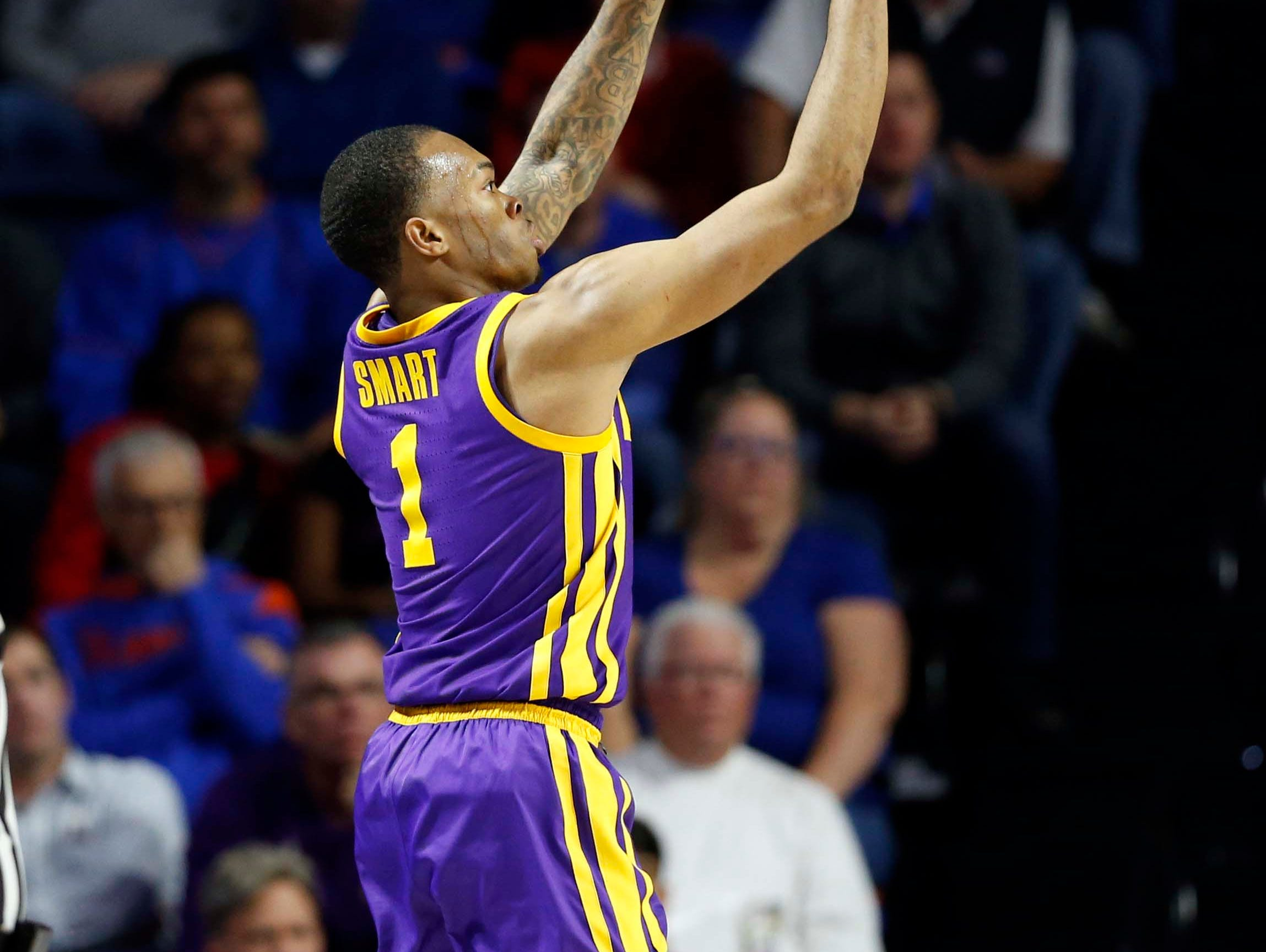 Mar 6, 2019; Gainesville, FL, USA; LSU Tigers guard Javonte Smart (1) makes a three pointer against the Florida Gators during the second half at Exactech Arena. Mandatory Credit: Kim Klement-USA TODAY Sports
