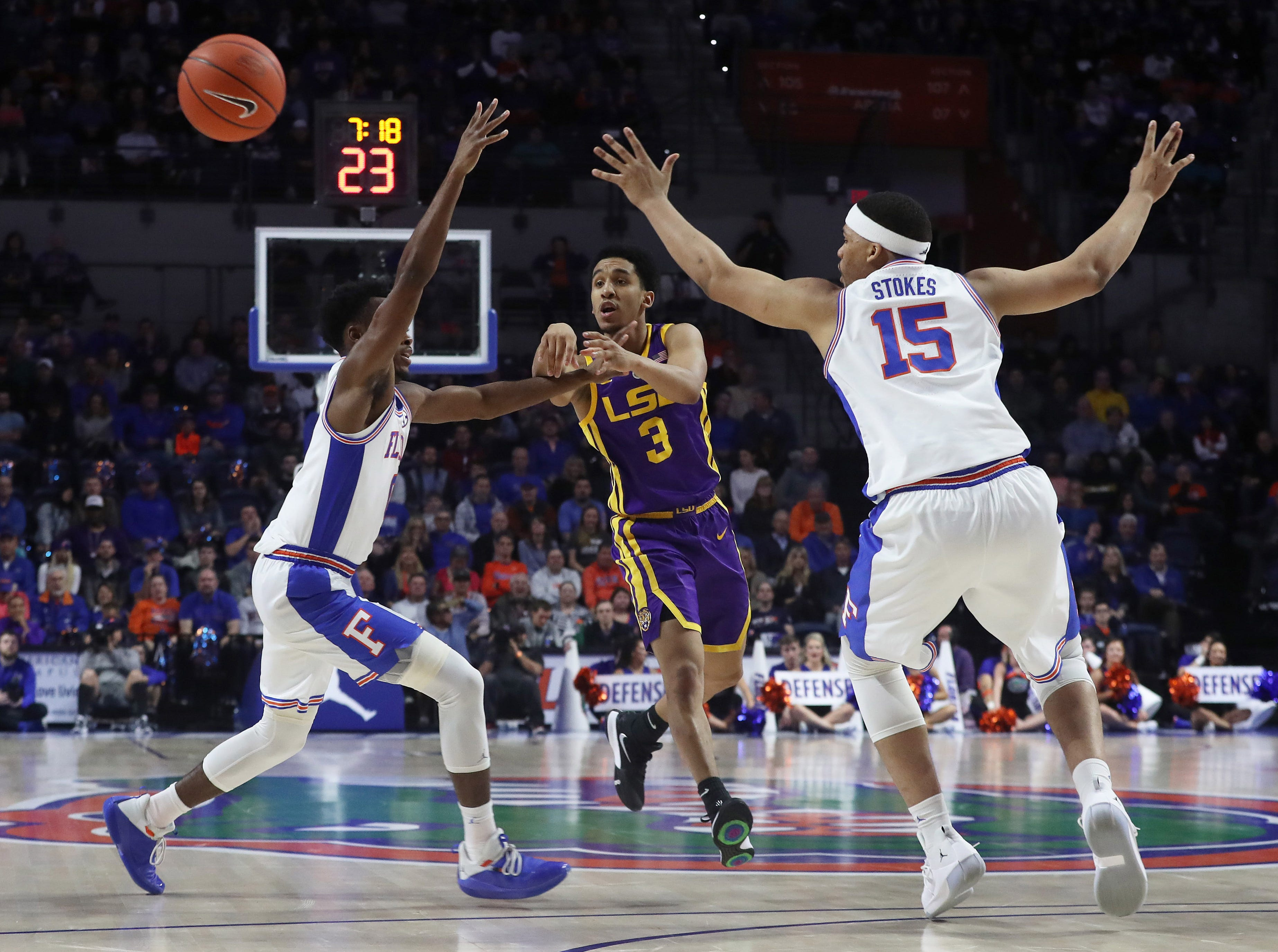 Mar 6, 2019; Gainesville, FL, USA; LSU Tigers guard Tremont Waters (3) passes the ball past Florida Gators guard Mike Okauru (0) and forward Isaiah Stokes (15) during the first half at Exactech Arena. Mandatory Credit: Kim Klement-USA TODAY Sports