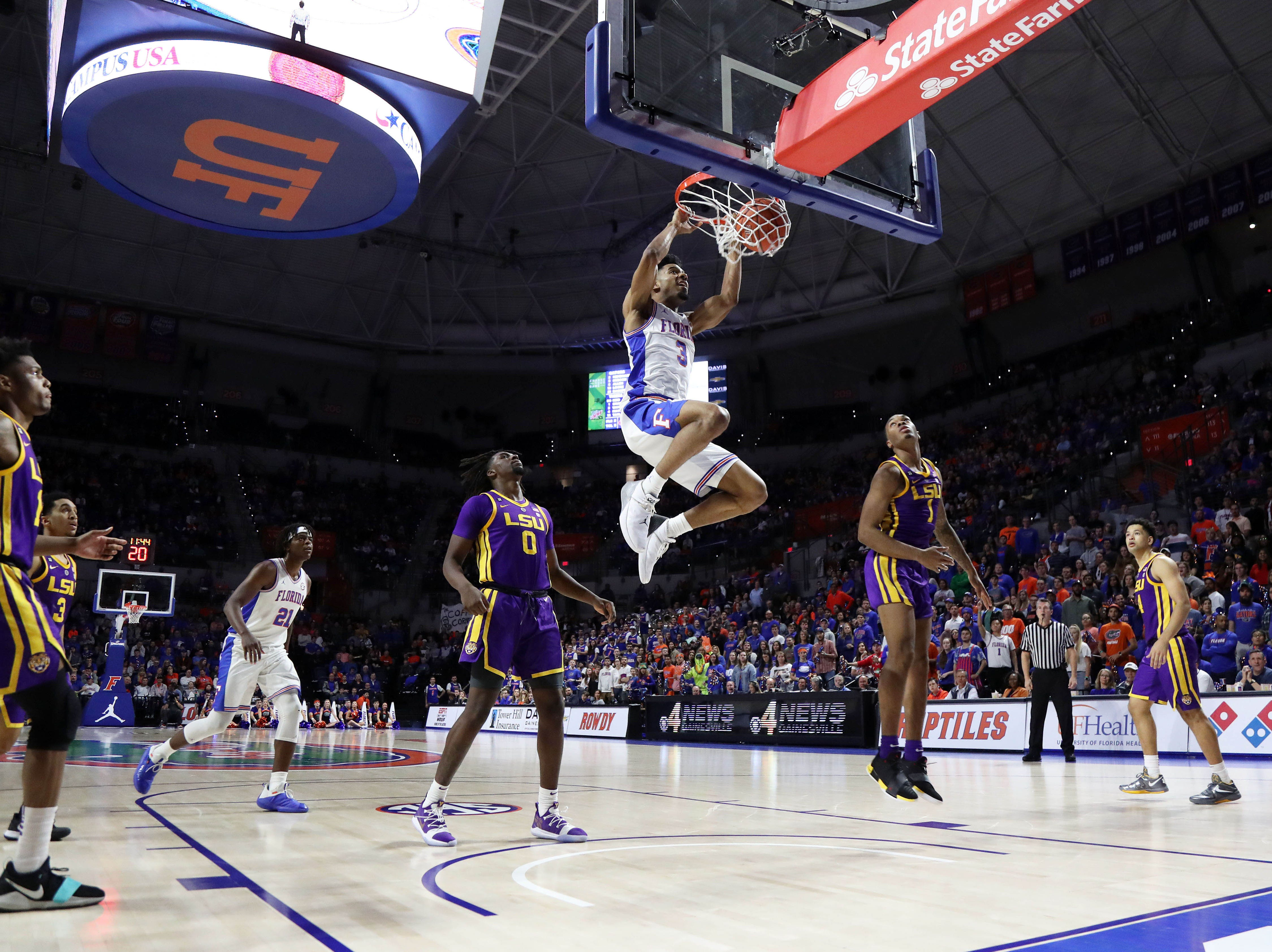 Mar 6, 2019; Gainesville, FL, USA;Florida Gators guard Jalen Hudson (3) dunks the ball against the LSU Tigers  during the second half at Exactech Arena. Mandatory Credit: Kim Klement-USA TODAY Sports
