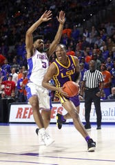 Mar 6, 2019; Gainesville, FL, USA; LSU Tigers guard Javonte Smart (1) drives to the basket as Florida Gators guard Jalen Hudson (3) defends during the first half at Exactech Arena. Mandatory Credit: Kim Klement-USA TODAY Sports